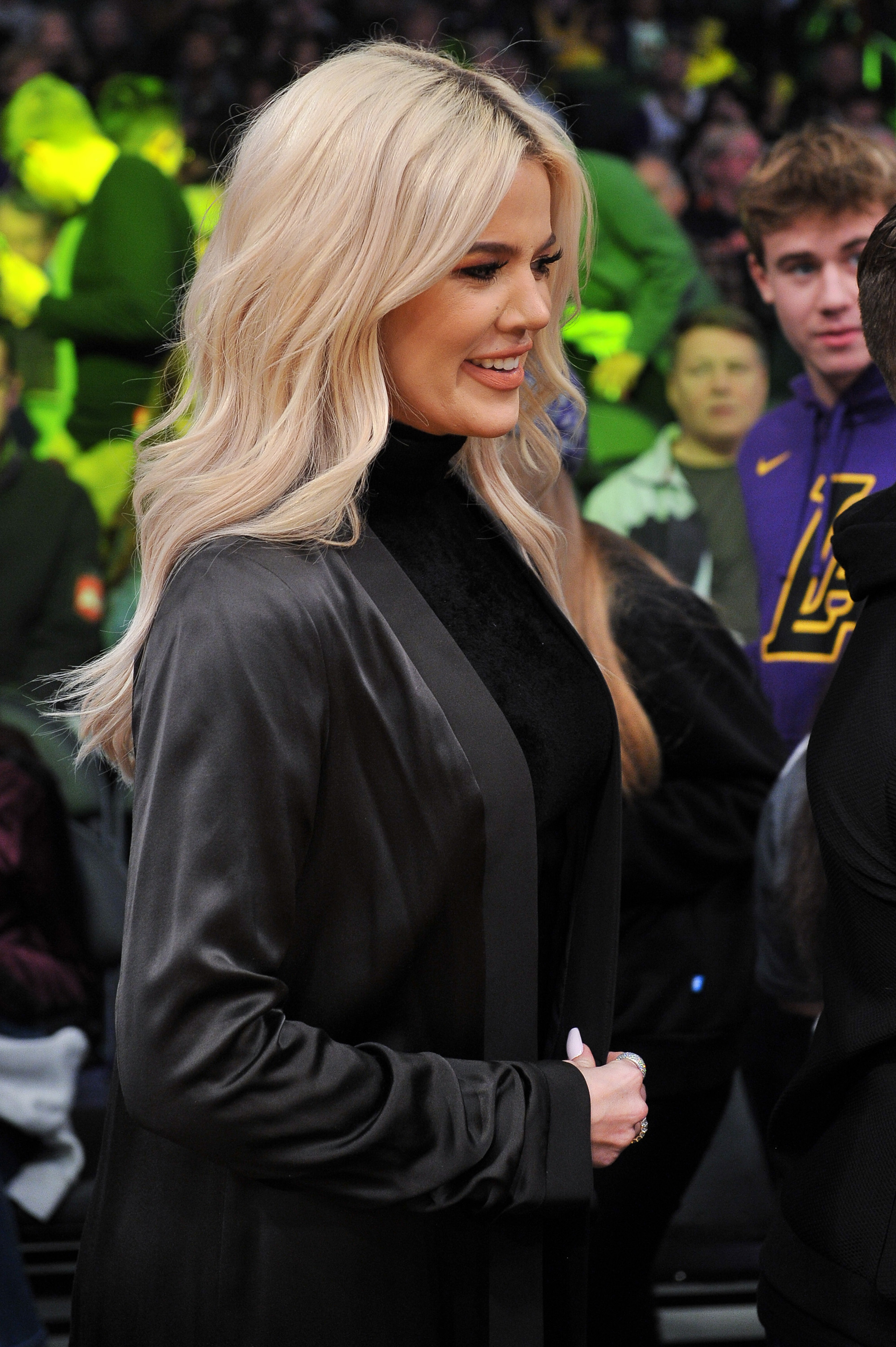 Khloe Kardashian Supports Beau Tristan Thompson Courtside at Cleveland Cavaliers Game - The reality TV personality stood tall and smiled at other attendees at the game as she held tight to a gray purse.