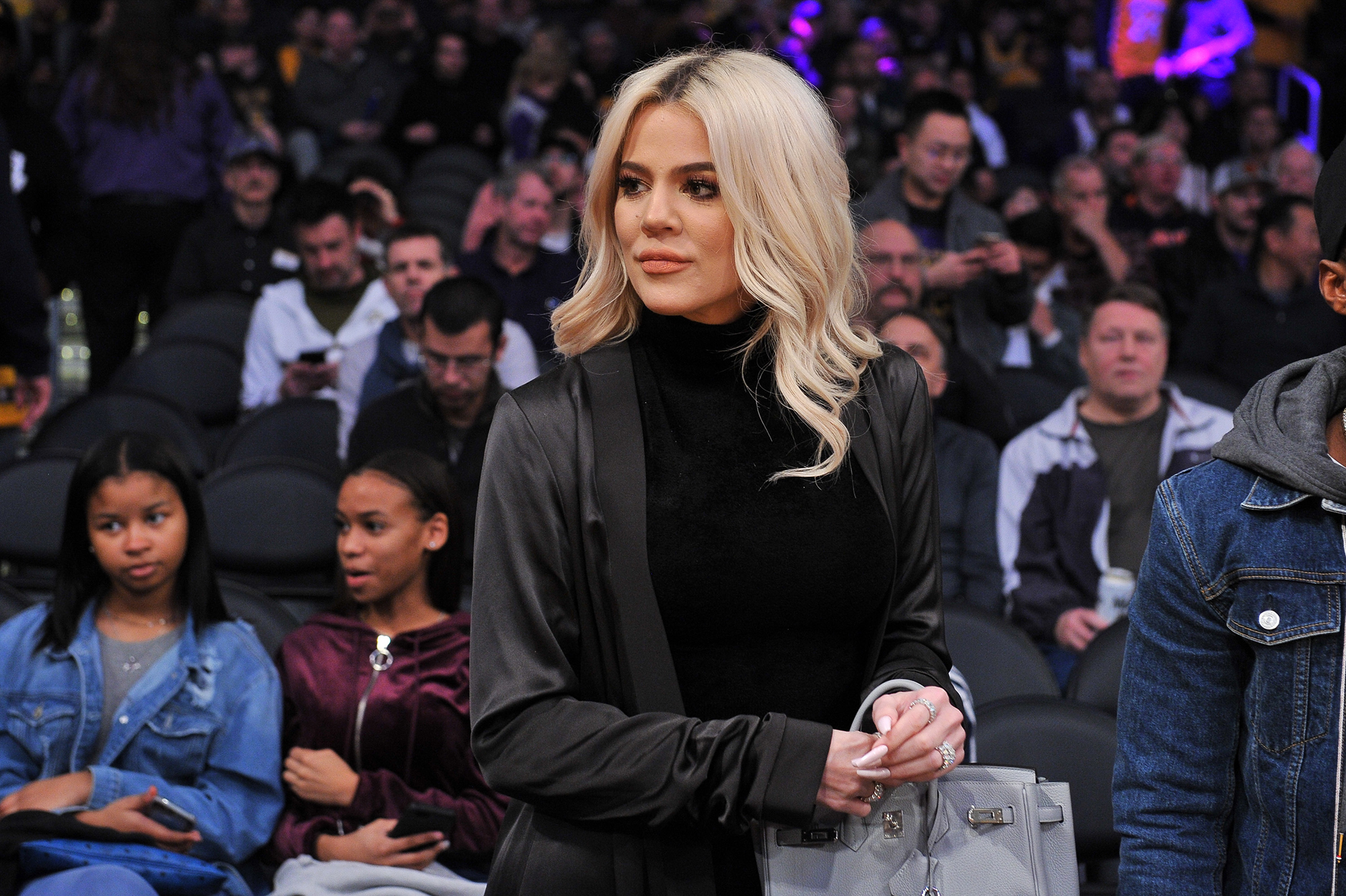"""Khloe Kardashian Supports Beau Tristan Thompson Courtside at Cleveland Cavaliers Game - Kardashian looked picture-perfect in a black turtleneck and long jacket. Thompson recently gushed over his love in the comments section of an Instagram post writing, """"True's mommy fine as hell."""""""