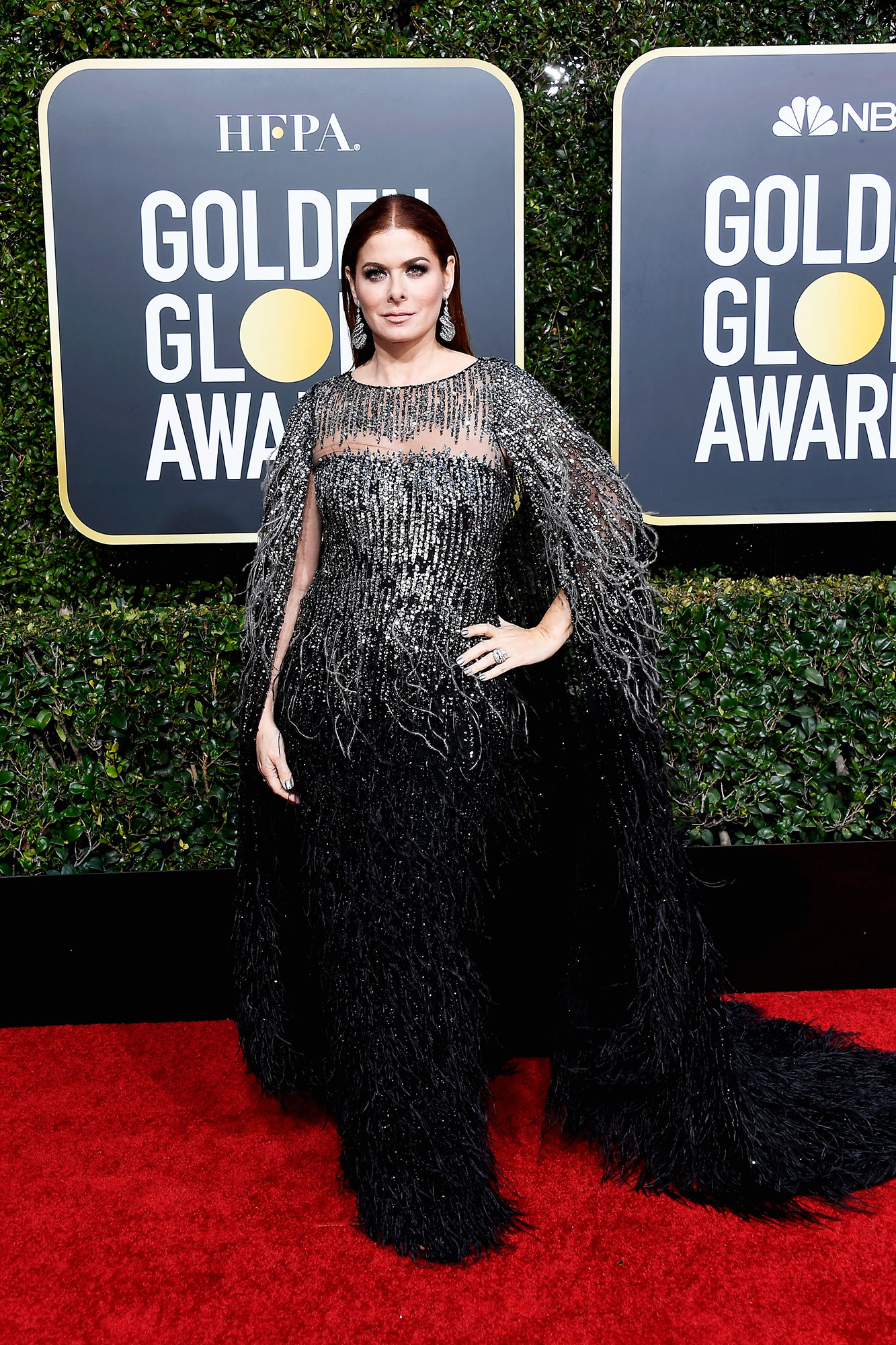 Debra Messing - In feather-adorned Pamella Roland on Jan. 6.
