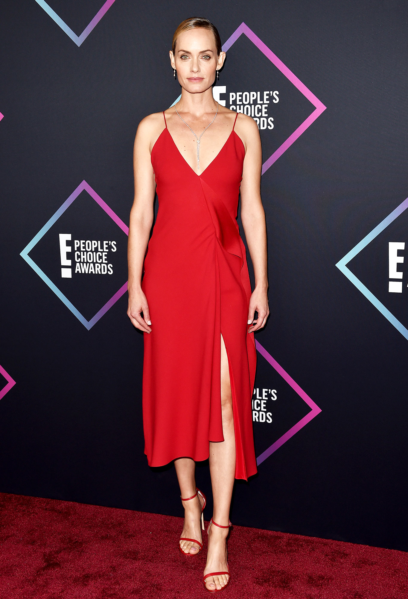 red carpet gallery for Stylish - Red Amber Valletta - In a Victoria Beckham cami dress on Nov. 11.