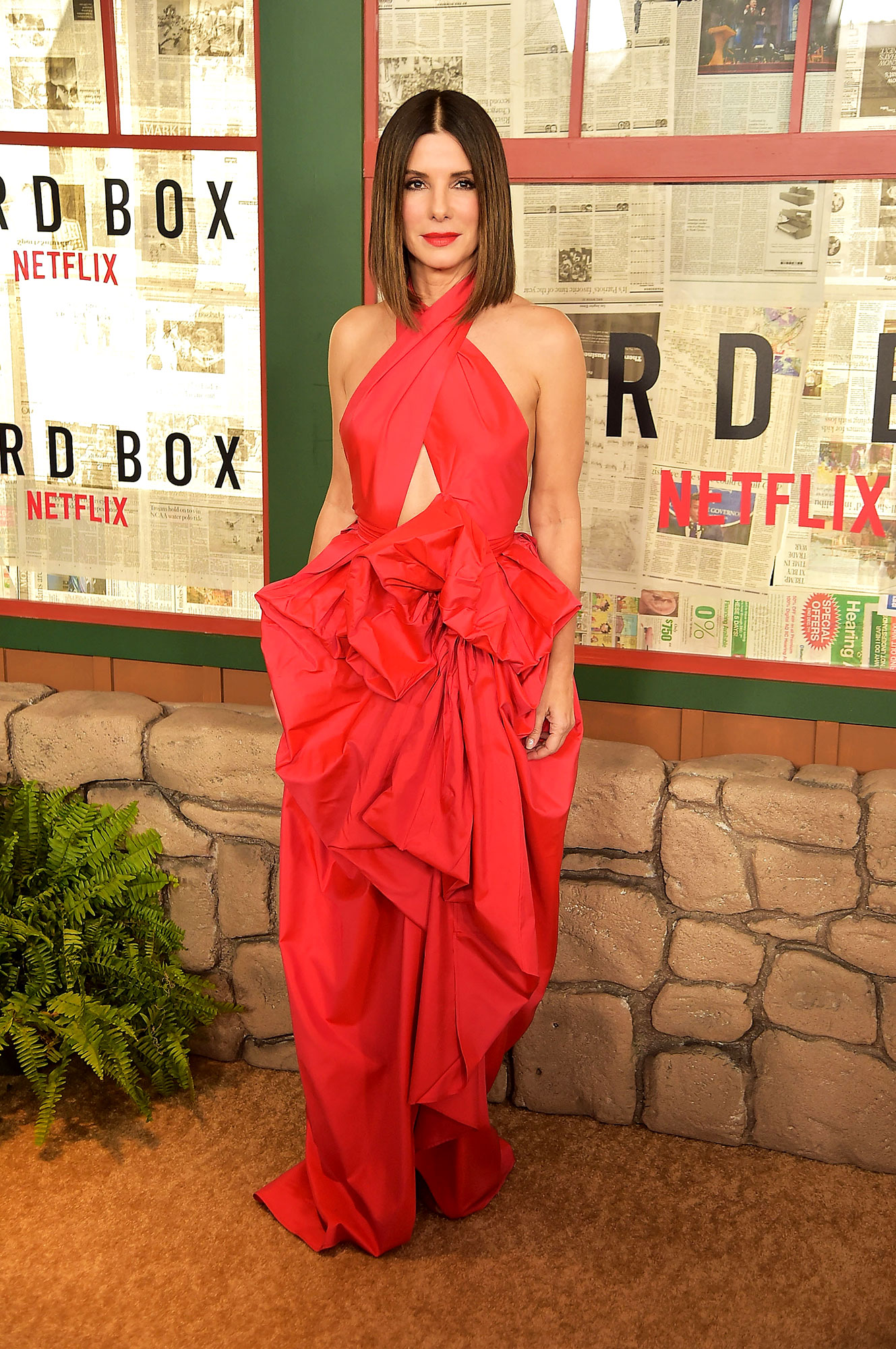 red carpet gallery for Stylish - Red Sandra Bullock - In a cut-out Martin Grant halter on Dec. 17.