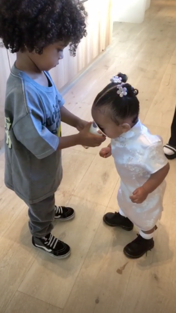 "Kim Kardashian, chicago west, birthday party, alice in wonderland - Saint shared a drink with his little sister. ""You are so nice sharing with your sister,"" Kim told her son, adding, ""These two are always together."""