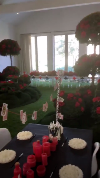 Kim Kardashian, chicago west, birthday party, alice in wonderland - Guests walked through a maze before arriving at a room decorated with ornamental trees and a table set up with white roses ready to be painted red.