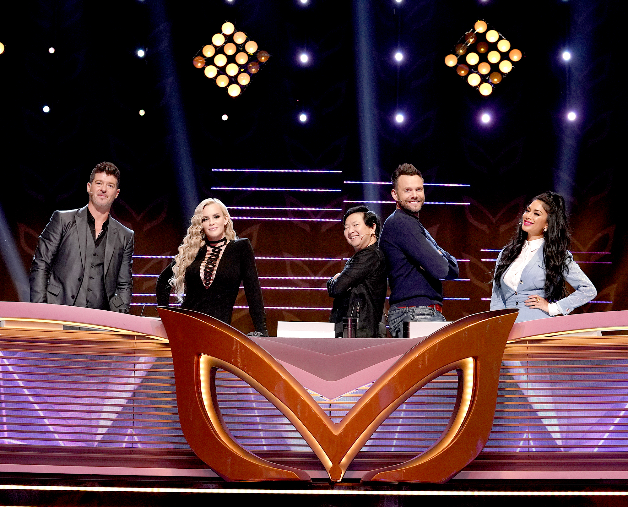 """the-masked-singer-judges-joel - THE MASKED SINGER: L-R: Panelists: Robin Thicke, Jenny McCarthy, Ken Jeong, guest panelist Joe McHale and panelist Nicole Scherzinger in the all-new """"Five Masks No More"""" episode of THE MASKED SINGER airing Wednesday, Jan. 16 (9:00-10:00 PM ET/PT) on FOX. © 2019 FOX Broadcasting."""