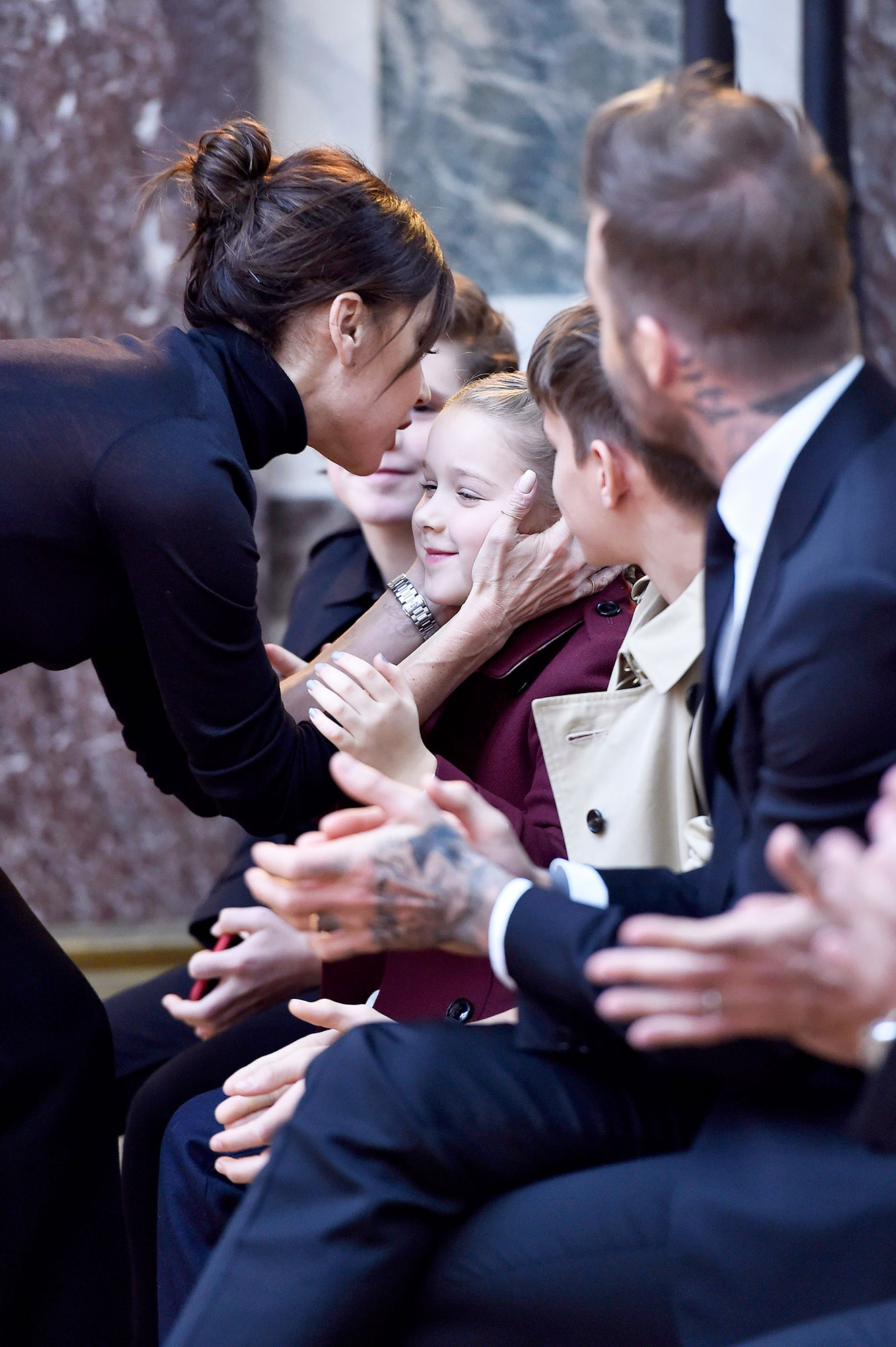 7-Year-Old Harper Beckham Gets a Clean Product Facial From Dr. Barbara Sturm - Fashion designer Victoria Beckham kisses her daughter Harper while her husband David Beckham looks on at the Victoria Beckham Autumn Winter 2018 fashion show during New York Fashion Week on February 10, 2018 in New York, United States.