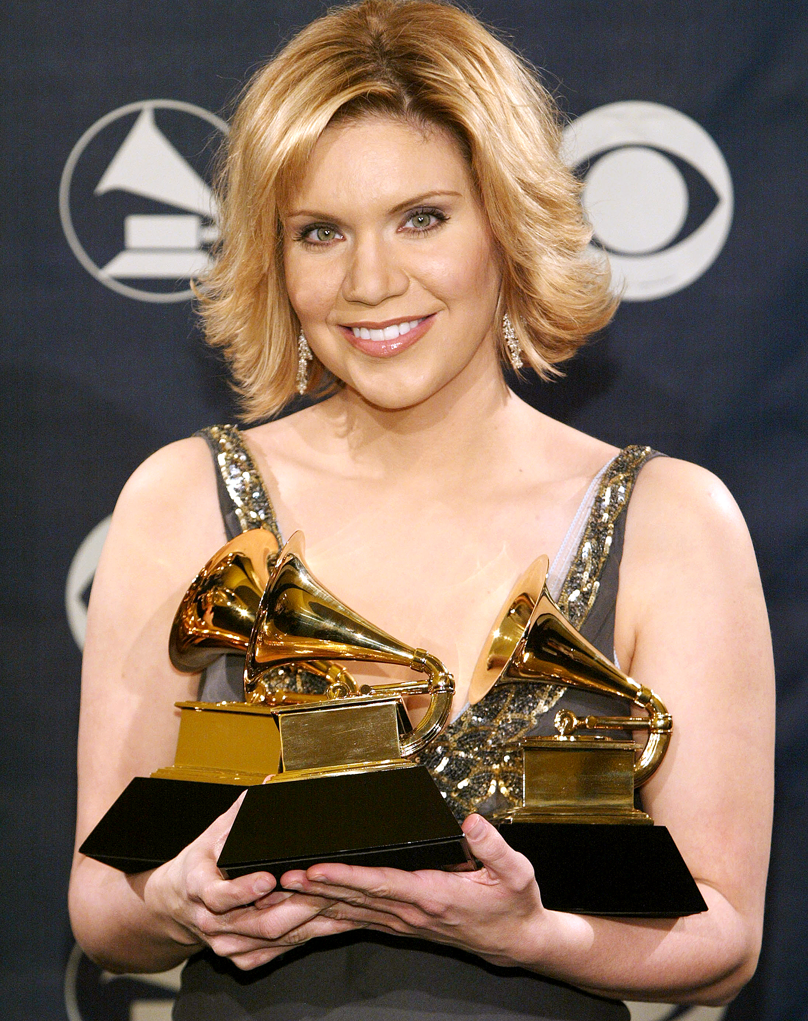 Alison-Krauss-grammy-awards - Country singer and musician Alison Krauss has won 27 Grammys thus far, most recently winning the award for Best Bluegrass Album in 2012 for Paper Airplane .