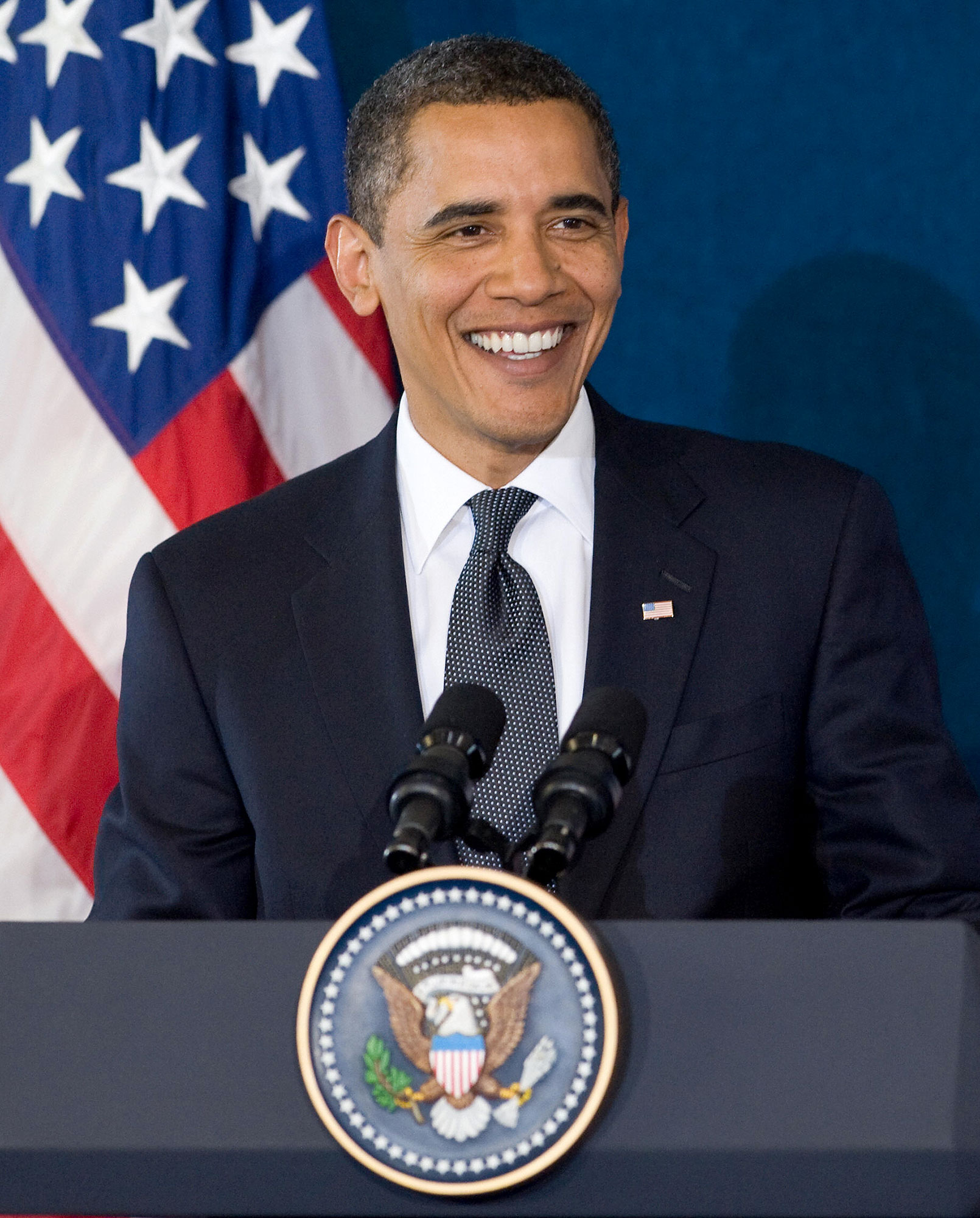 Stars You Wouldn't Expect to Be Grammy Nominees or Winners - US President Barack Obama smiles as he gives during a press conference at the Group of Eight (G8) summit in L'Aquila, central Italy, on July 10, 2009. G8 leaders, including an Africa-bound Barack Obama, vowed today to stand by the world's poor despite the downturn, unveiling a 15 billion dollar boost for food production.