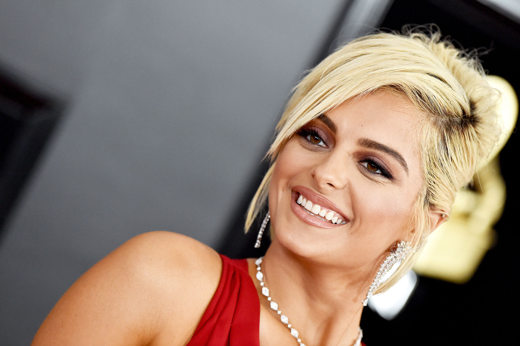 "grammys 2019 Bebe Rexha - A 'do to die for! Stylist Ursula Stephen created a ""gritty half-up style"" for the 'I Got You' singer and the imperfect nature of it makes it super easy to achieve. After prepping hair with TRESemme Thermal Creations Blow Dry Balm from roots to ends and spritzing with TRESemme's Thermal Creations Blow Dry Accelerator Spray , Stephen rough-dried locks using a paddle brush to smooth."
