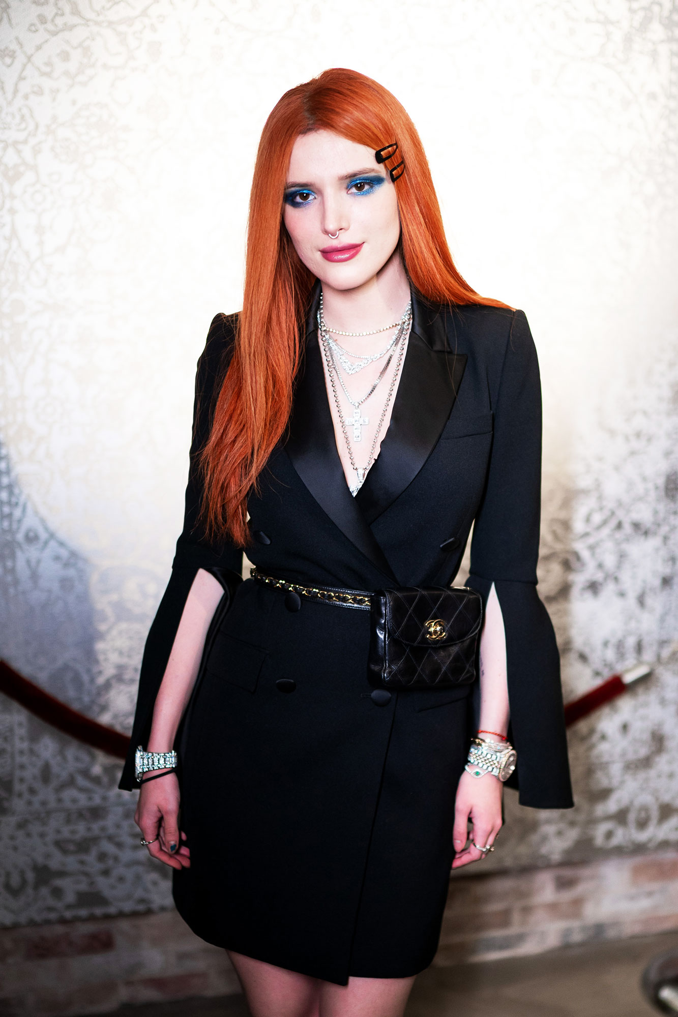 Bella Thorne - When attending the Daily Front Row Kick Off Party on February 7, the actress wore a super sexy tuxedo jacket dress with slits up the long sleeves and a chain belt.