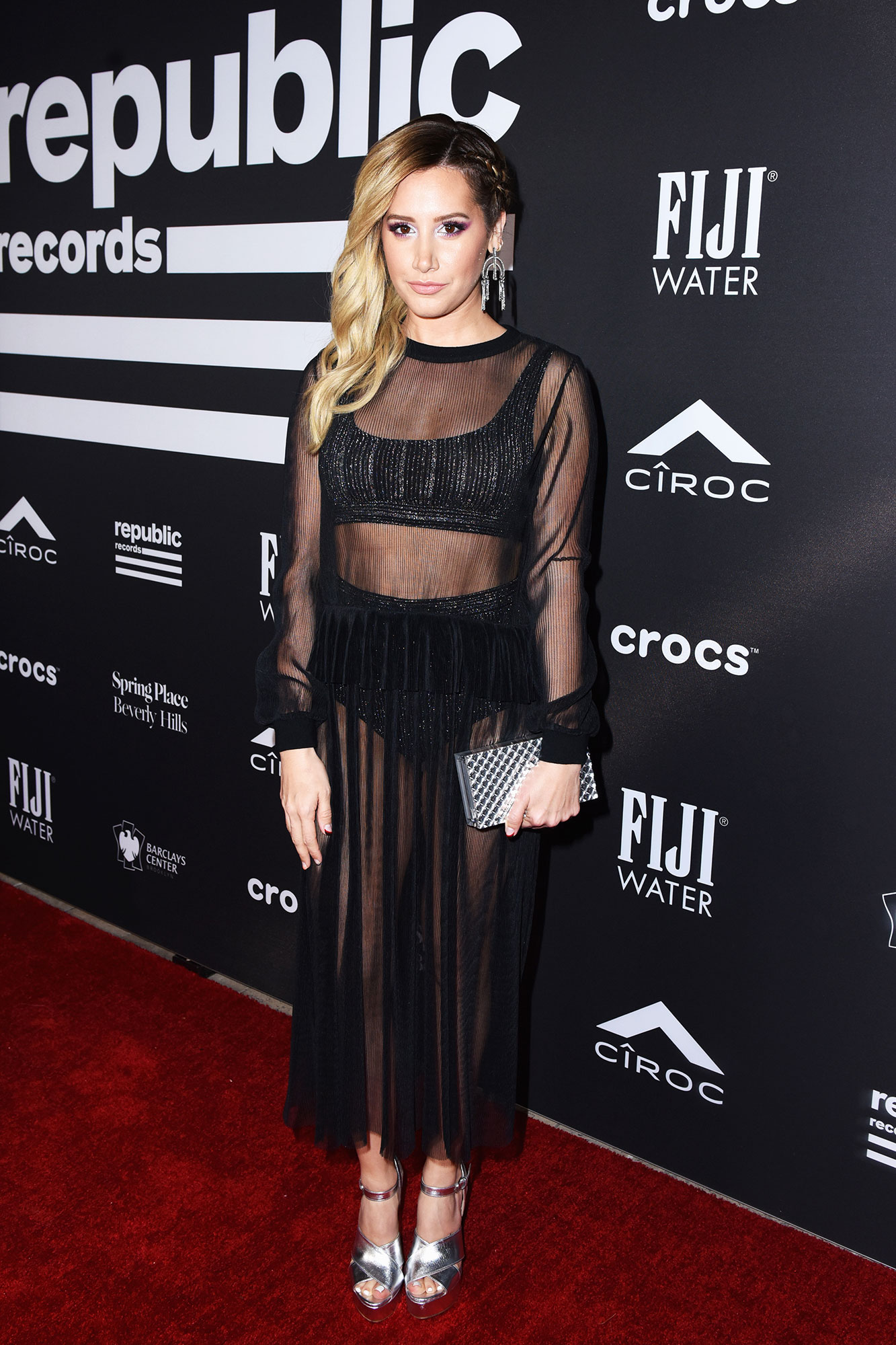 Ashley Tisdale grammys 2019 - The former Disney-channel star hit up the FIJI Water At Republic Records Grammy party in a sheer black ankle-cut dress.