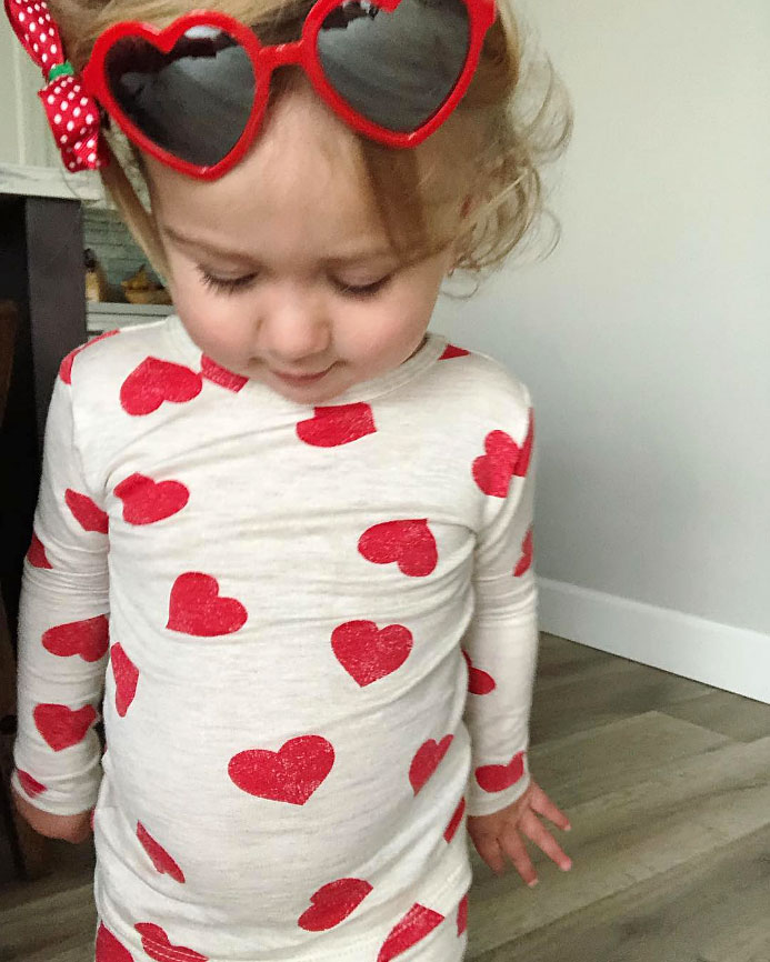 Birdie Danielson Cute Celebrity Kids Celebrating Valentine's Day - Brie Bella 's daughter matched her heart-shaped sunglasses to her pajamas.