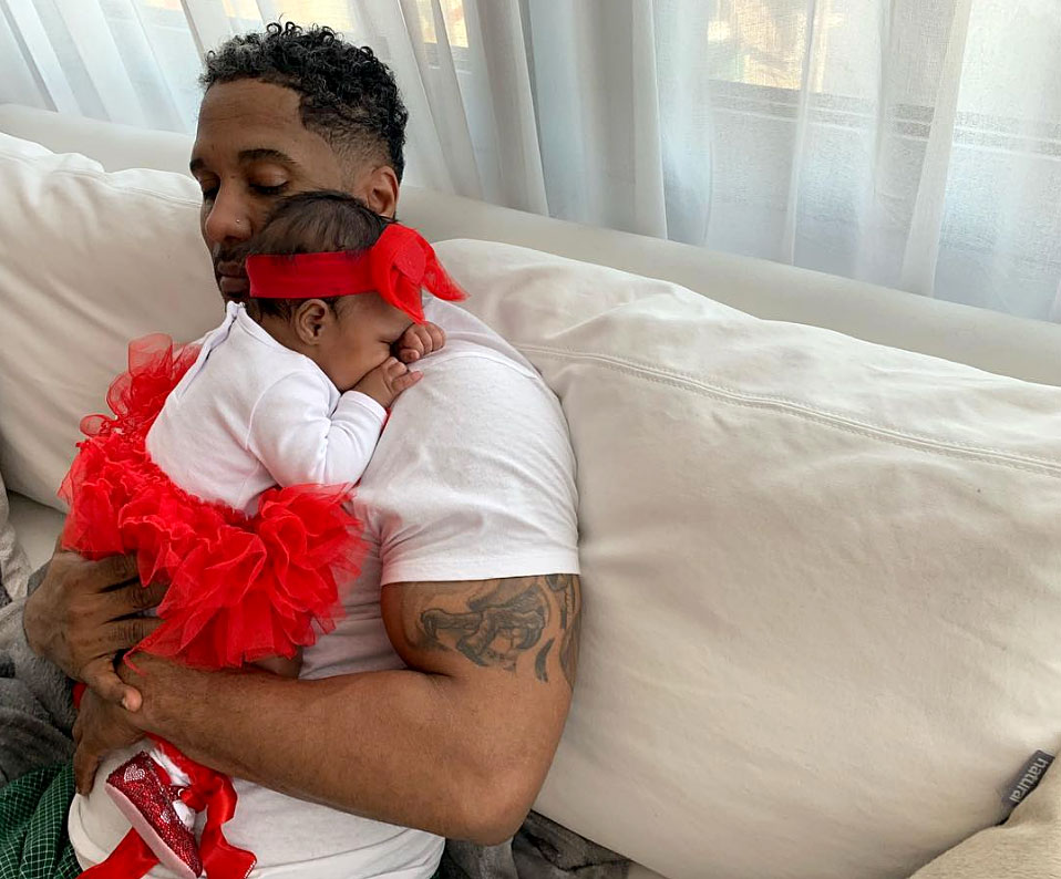 Brooklyn Daly Cute Celebrity Kids Celebrating Valentine's Day - Kenya Moore 's daughter cuddled with her dad, Marc Daly , in a red tutu, sparkly shoes and a matching headband.