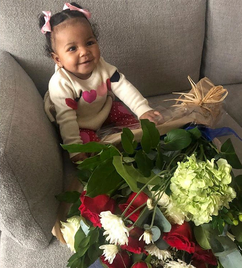 Cute Celebrity Kids Celebrating Valentine's Day - Chanel Iman and Sterling Shepard 's daughter wore a heart sweater with matching leggings, plus pink bows in her hair, on Valentine's Day. The model shared a photo of Cali sitting on the couch with a bouquet of flowers.