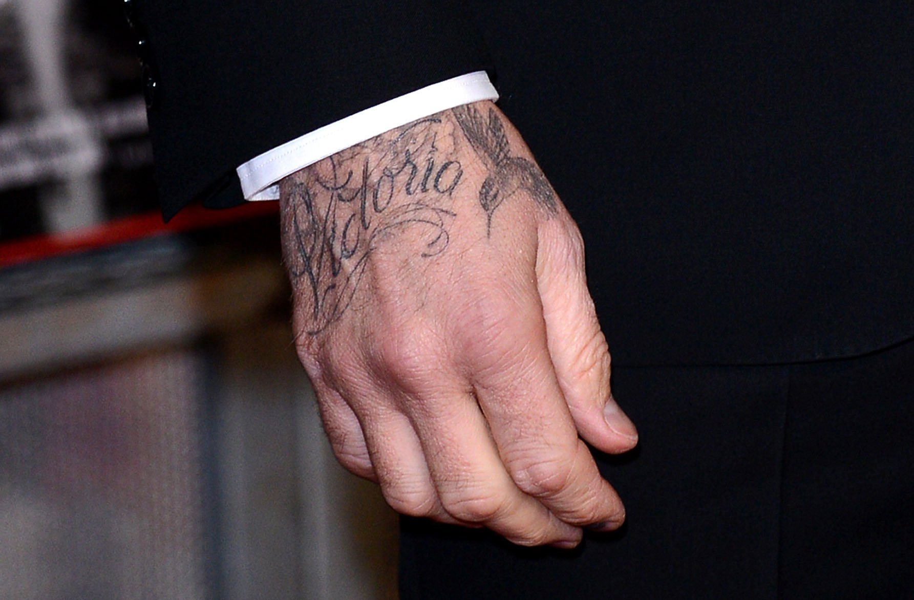 Victoria and David Beckham timeline gallery - David showcased his love for his wife through ink once more in September 2013, when he showed up to The Global Fund at Apsley House in London with her name tattooed in cursive across his right hand .