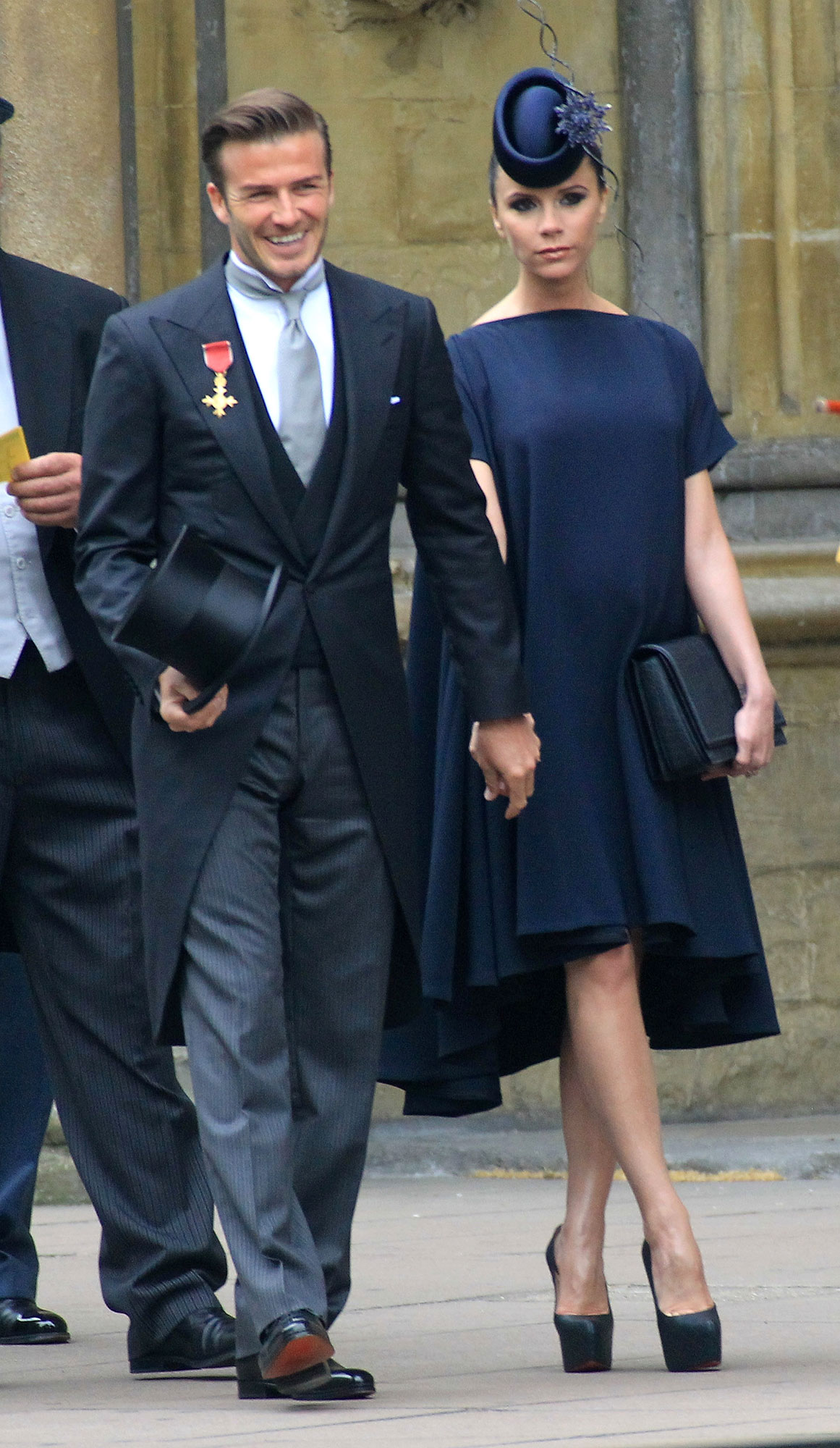 Victoria and David Beckham timeline gallery - A pregnant Victoria ventured across the pond with David in April 2011 for Prince William and Duchess Kate 's royal wedding . They were dressed impeccably for the occasion, with the businesswoman in a navy frock from her eponymous fashion line and a matching fascinator from Philip Treacy, and David opting for a dark Ralph Lauren suit.