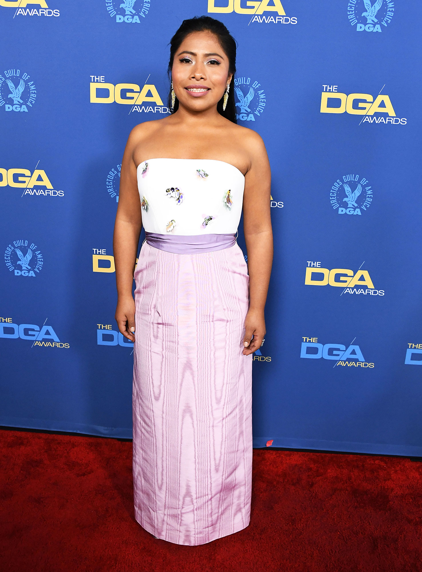 Yalitza Aparicio attends the 71st Annual Directors Guild Of America Awards at The Ray Dolby Ballroom at Hollywood - In a white and purple strapless dress, the Roma star looked as elegant as ever.
