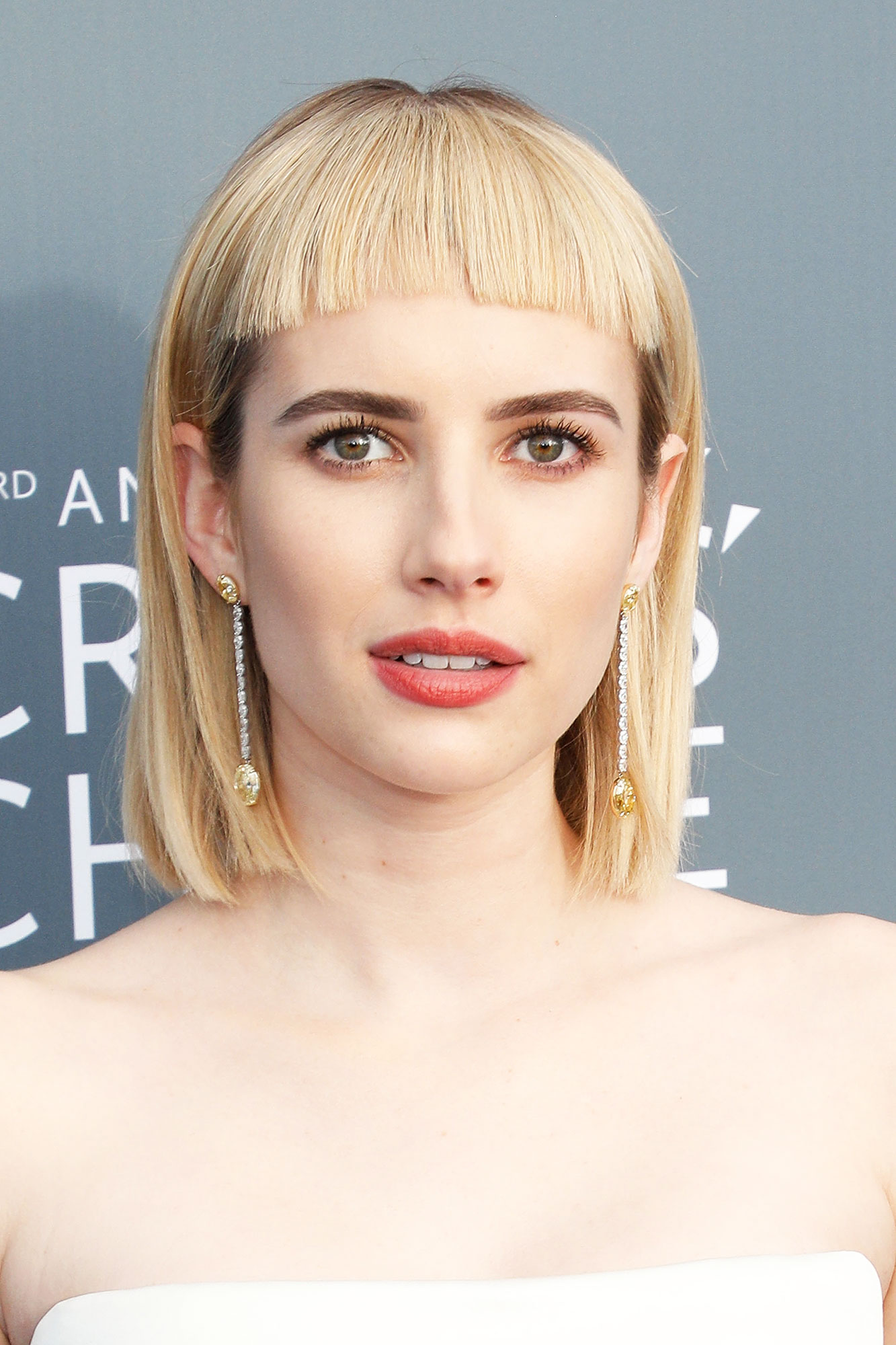 Emma Roberts Celebrity Bangs: Fierce Fringe Inspo For Your Next Haircut - It was all about the retro vibes for the blonde beauty at the 2018 Critics' Choice Awards, where she debuted blonde micro bangs with her blunt bob hairstyle.