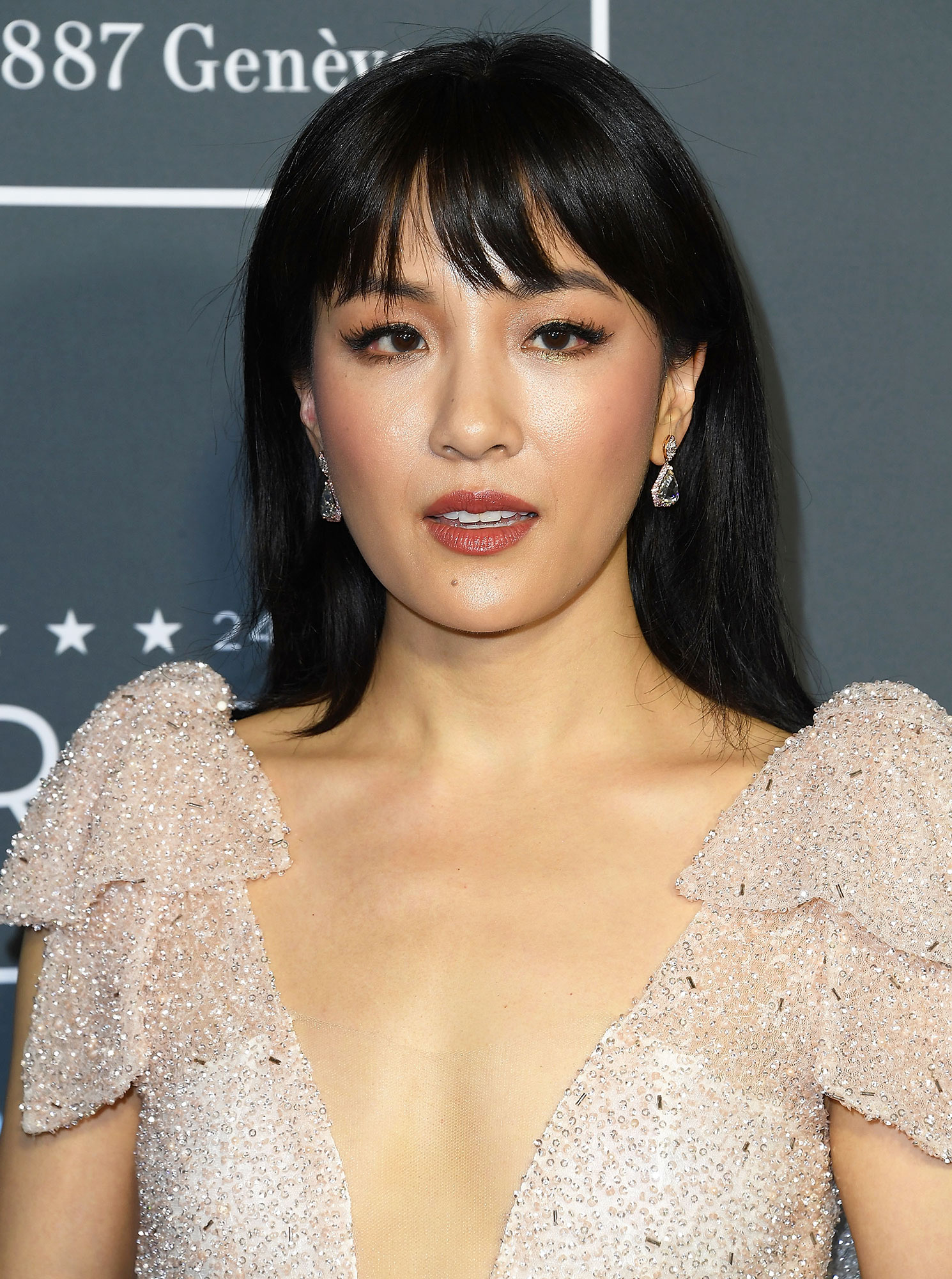 Constance Wu Celebrity Bangs: Fierce Fringe Inspo For Your Next Haircut - At the 2019 Critics Choice Awards, celeb hairstylist Derek Yuen used the ghd Natural Bristle Radial Brush to blowout and create a slight bevel at the ends of the Crazy Rich Asians star's piece-y bangs.