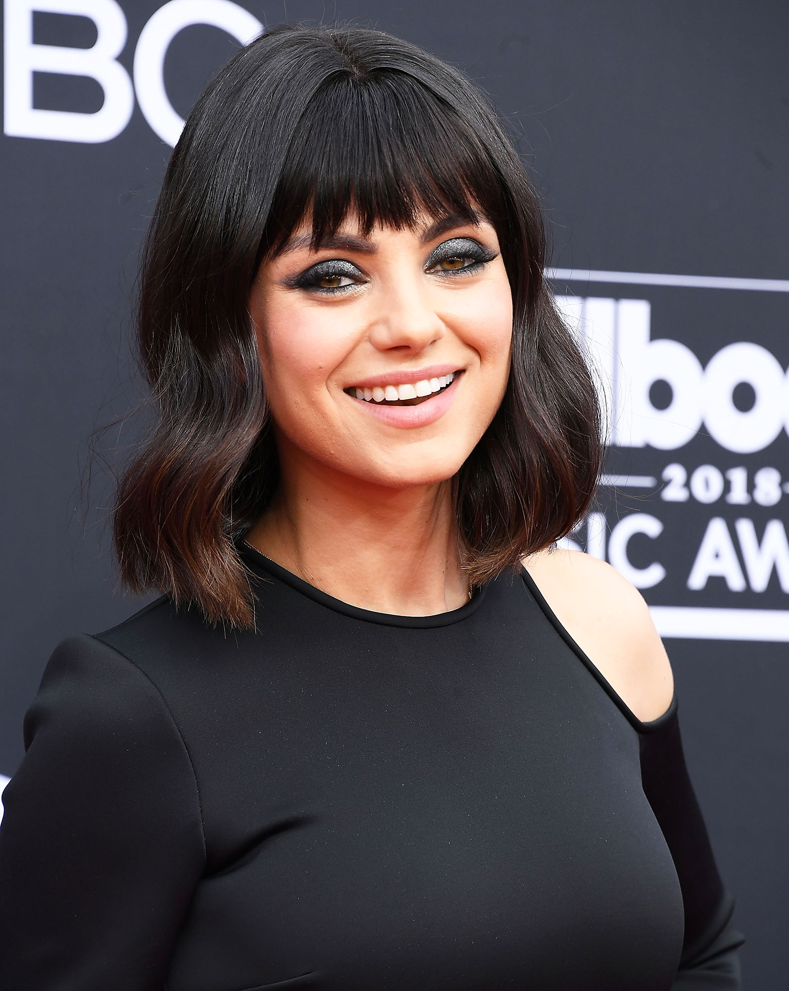 Mila Kunis Celebrity Bangs: Fierce Fringe Inspo For Your Next Haircut - Mane man Chad Wood updated the raven-haired beauty's already trendy bob with choppy bangs for the 2018 Billboard Music Awards.