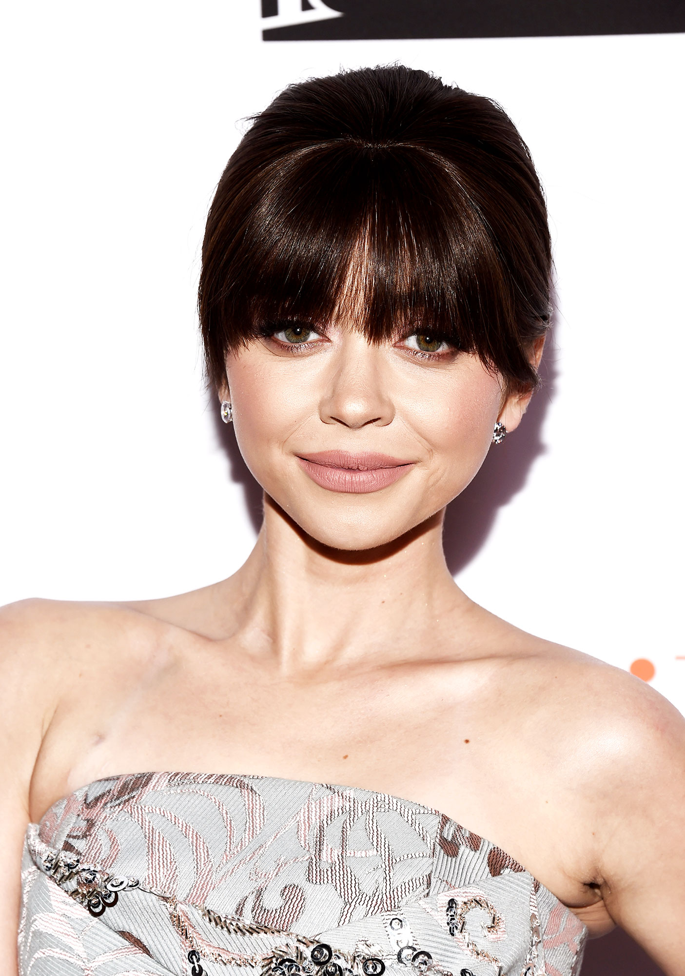 Sarah Hyland Celebrity Bangs: Fierce Fringe Inspo For Your Next Haircut - The Modern Family actress' heavy fringe at an April 2018 may have been the work of a hairpiece, but pro Ryan Richman shared on Instagram that he added some volume to the blunt strands by spritzing the AG Hair Tousled Texture Spray at the roots.