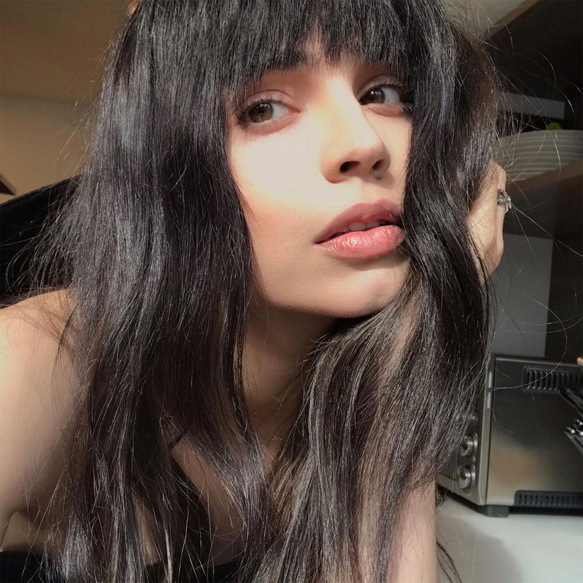 Sofia Carson Celebrity Bangs: Fierce Fringe Inspo For Your Next Haircut - The Pretty Little Liars: The Perfectionists star debuted a choppy, rock 'n' roll curtain bang by mane man Calie Noble in February 2019.