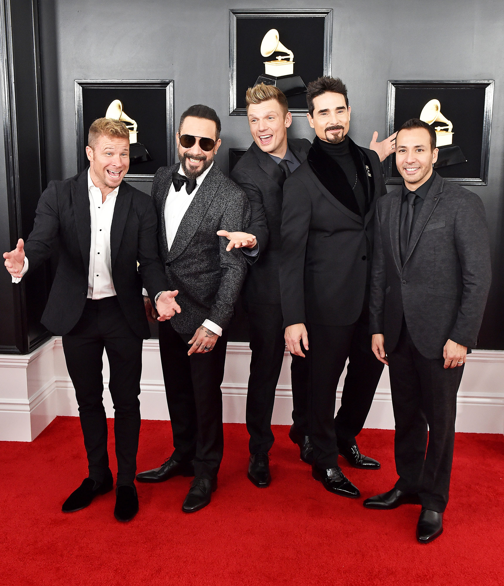 grammys 2019 Brian Littrell, AJ McLean, Nick Carter, Kevin Richardson, and Howie Dorough of Backstreet Boys - Kevin Richardson was dapper in charcoal Giorgio Armani and the rest of his bandmates followed suit (pun intended!) in various shades of grey.