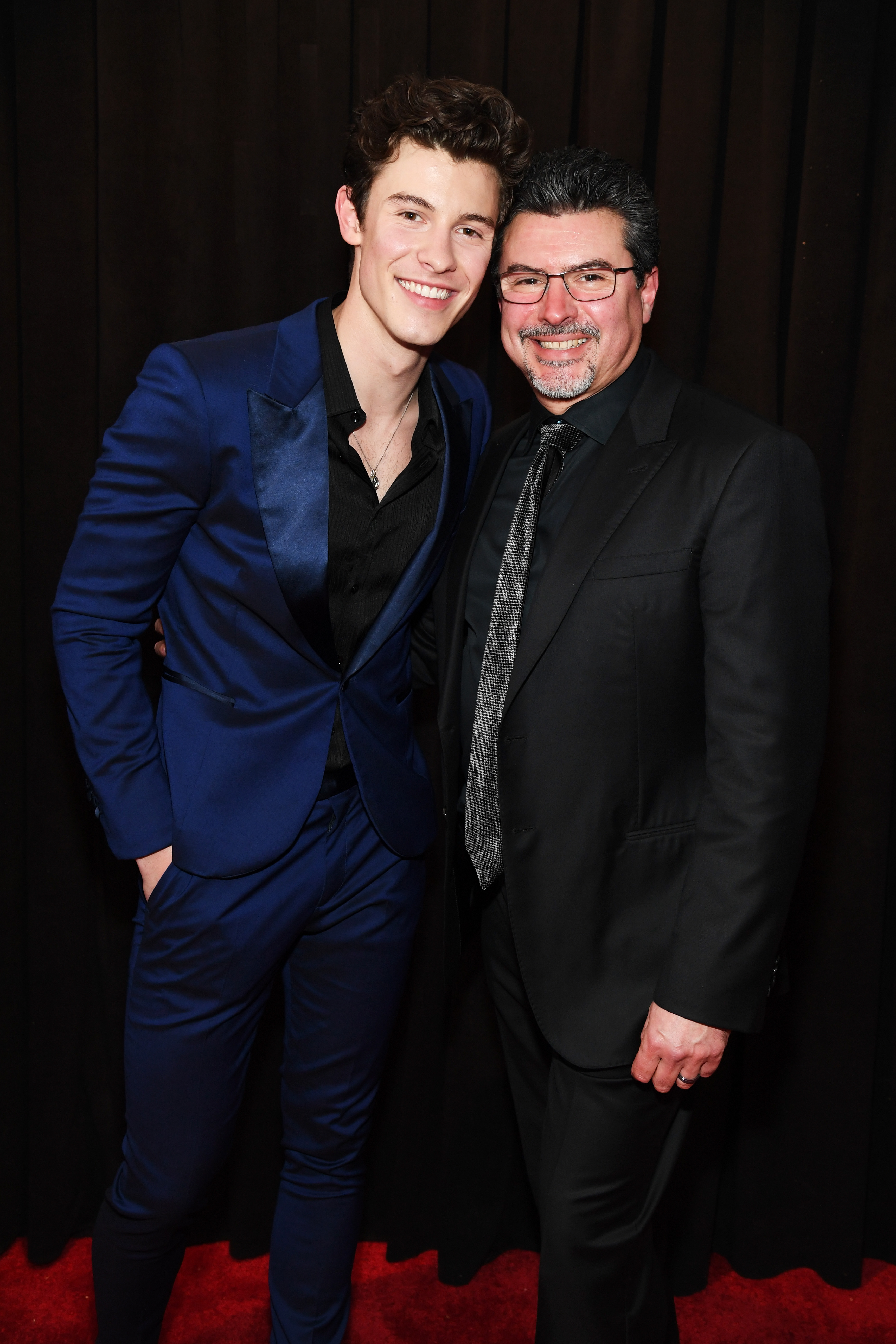 """Grammys 2019: Shawn Mendes, Miley Cyrus and More Stars Who Brought Family Members as Dates - The """"In My Blood"""" singer, who is nominated for Song of the Year and Best Pop Vocal Album, took an adorable photo with his father."""