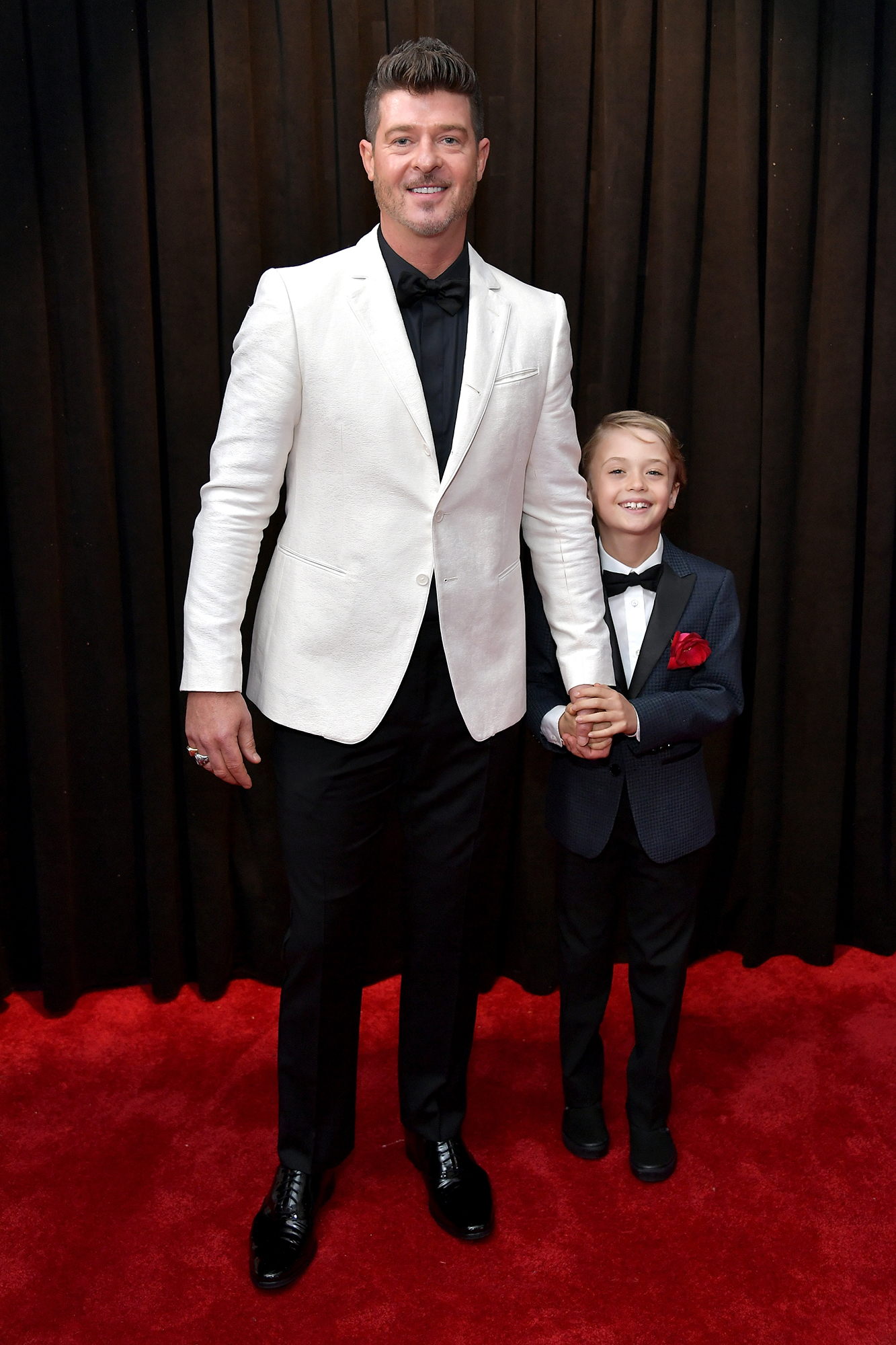 """Grammys 2019: Shawn Mendes, Miley Cyrus and More Stars Who Brought Family Members as Dates - The """"Blurred Lines"""" crooner walked the carpet with son Julian, 8, whom he shares with ex-wife Paula Patton."""