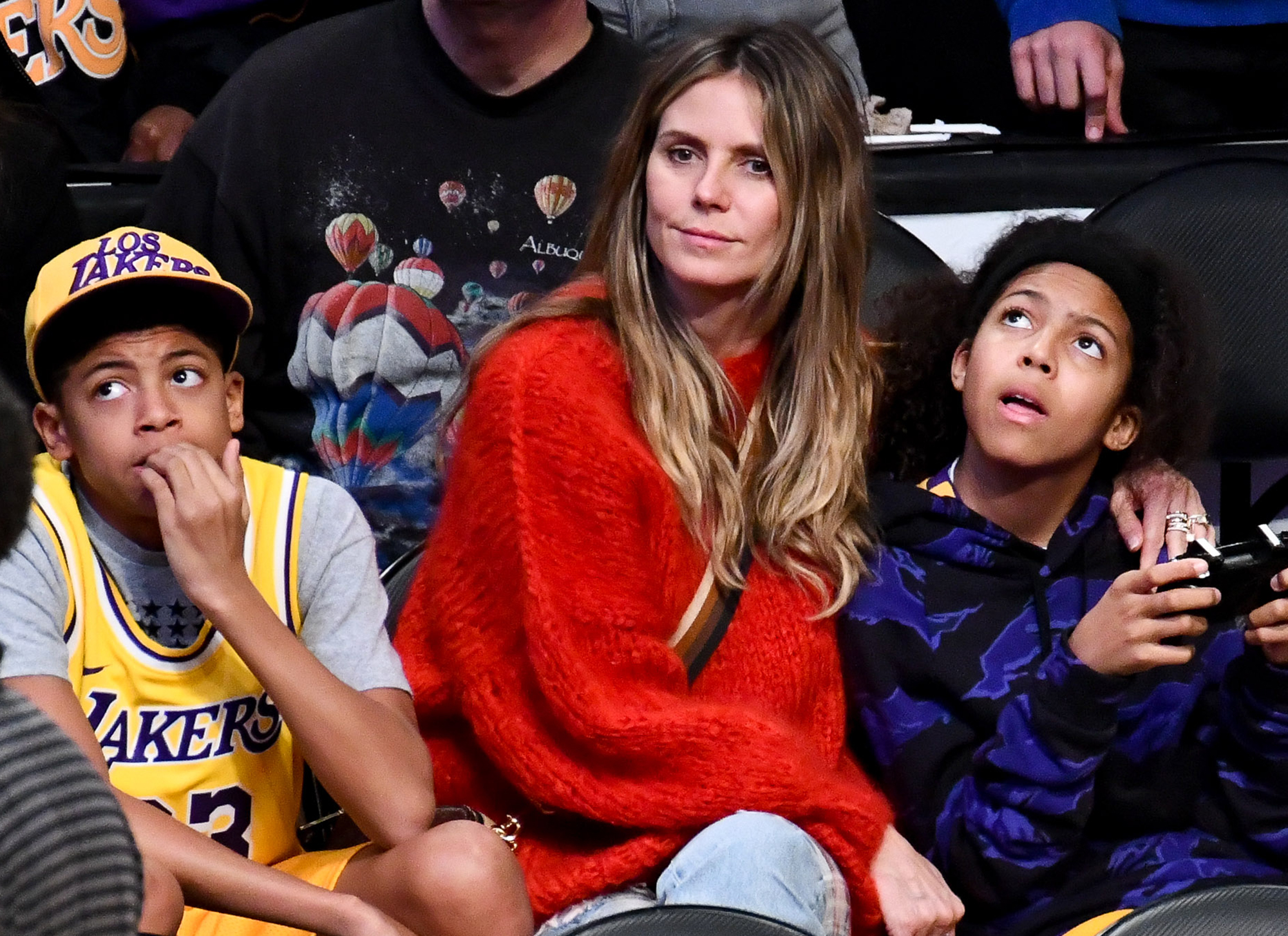 Heidi Klum and Tom Kaulitz Already Have 2 Bridesmaids and 2 Groomsmen in Their Wedding - Heidi Klum and her kids Henry Samuel and Lou Samuel attend a basketball game between the Los Angeles Lakers and the Minnesota Timberwolves at Staples Center on January 24, 2019 in Los Angeles, California.
