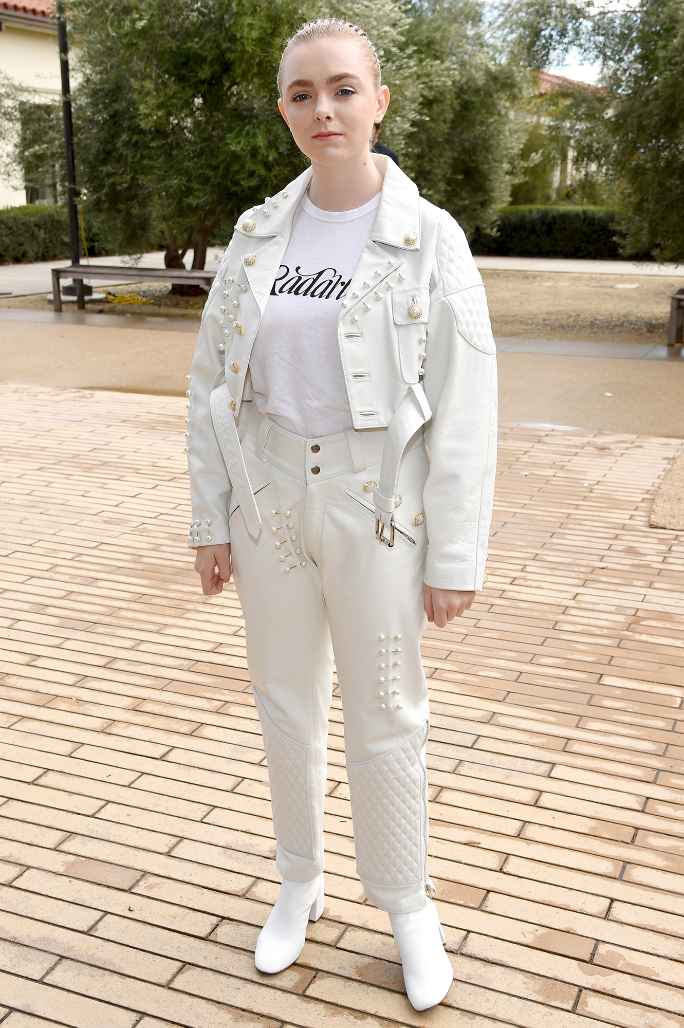 Hollywood's Freshest Faces Were Front Row at the Rodarte Show - She wears the pants! The Eighth Grade actress rocked a pearl-adorned white leather cropped jacket and matching quilted trousers.