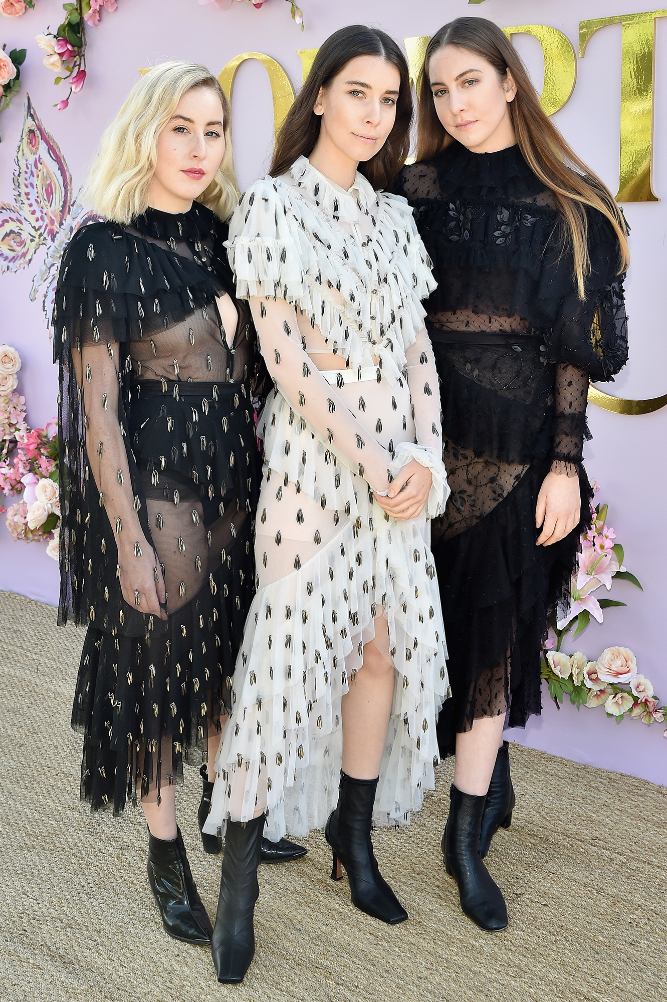 Hollywood's Freshest Faces Were Front Row at the Rodarte Show - The sister act kept things color coordinated in frilly black and white frocks.