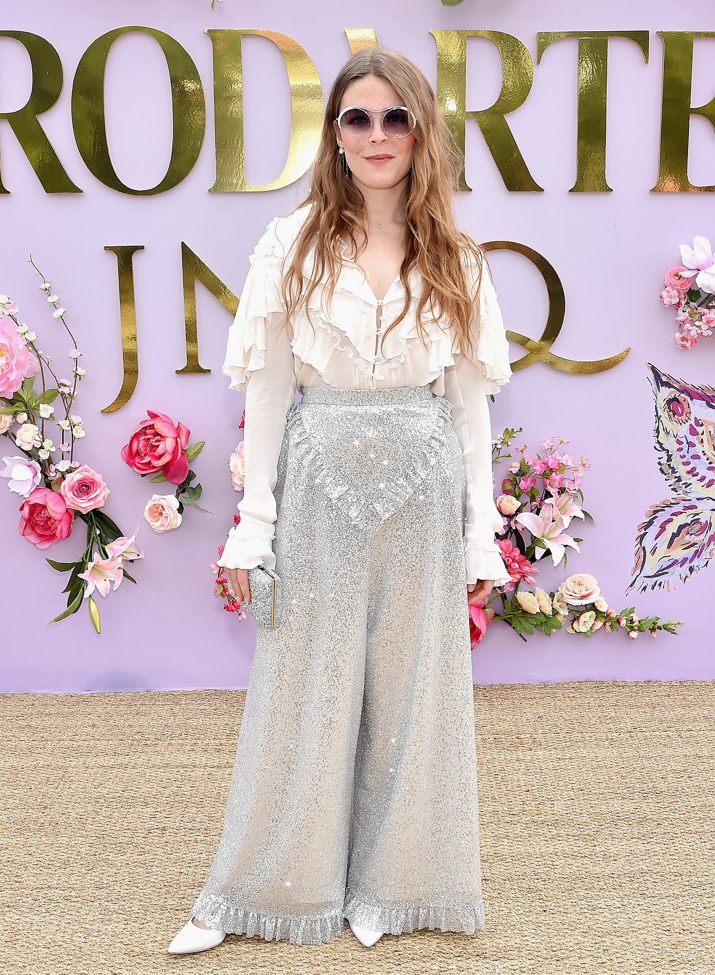"Hollywood's Freshest Faces Were Front Row at the Rodarte Show - The ""Light On"" songstress was all kinds of cool in sparkling palazzo pants and a white ruffled blouse."
