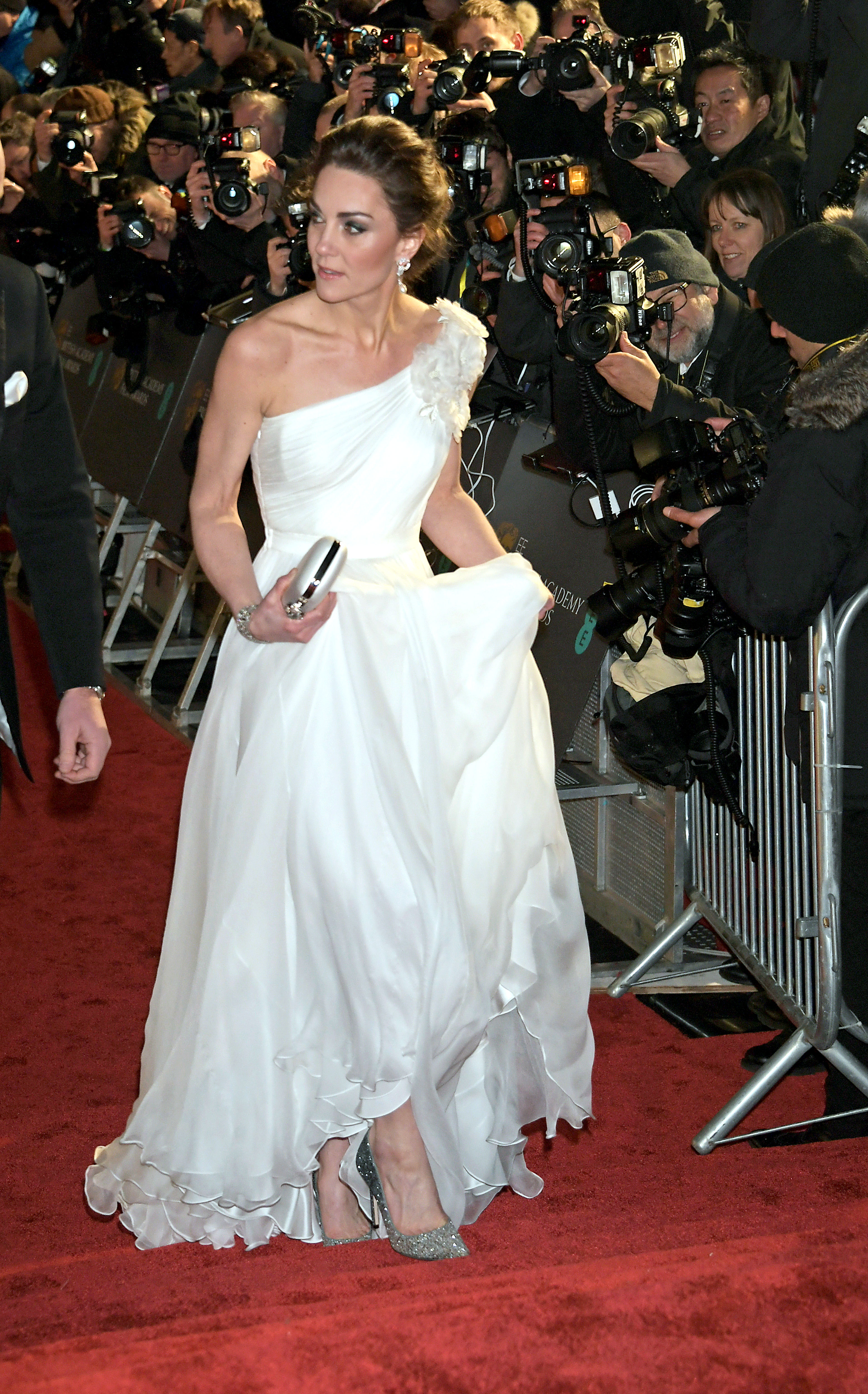 Kate Middleton Stuns at the BAFTAs - Kate's chiffon dress is by Alexander McQueen. She teamed it with Jimmy Choo Romy in Viola Glitter heels and a silver and white clutch.