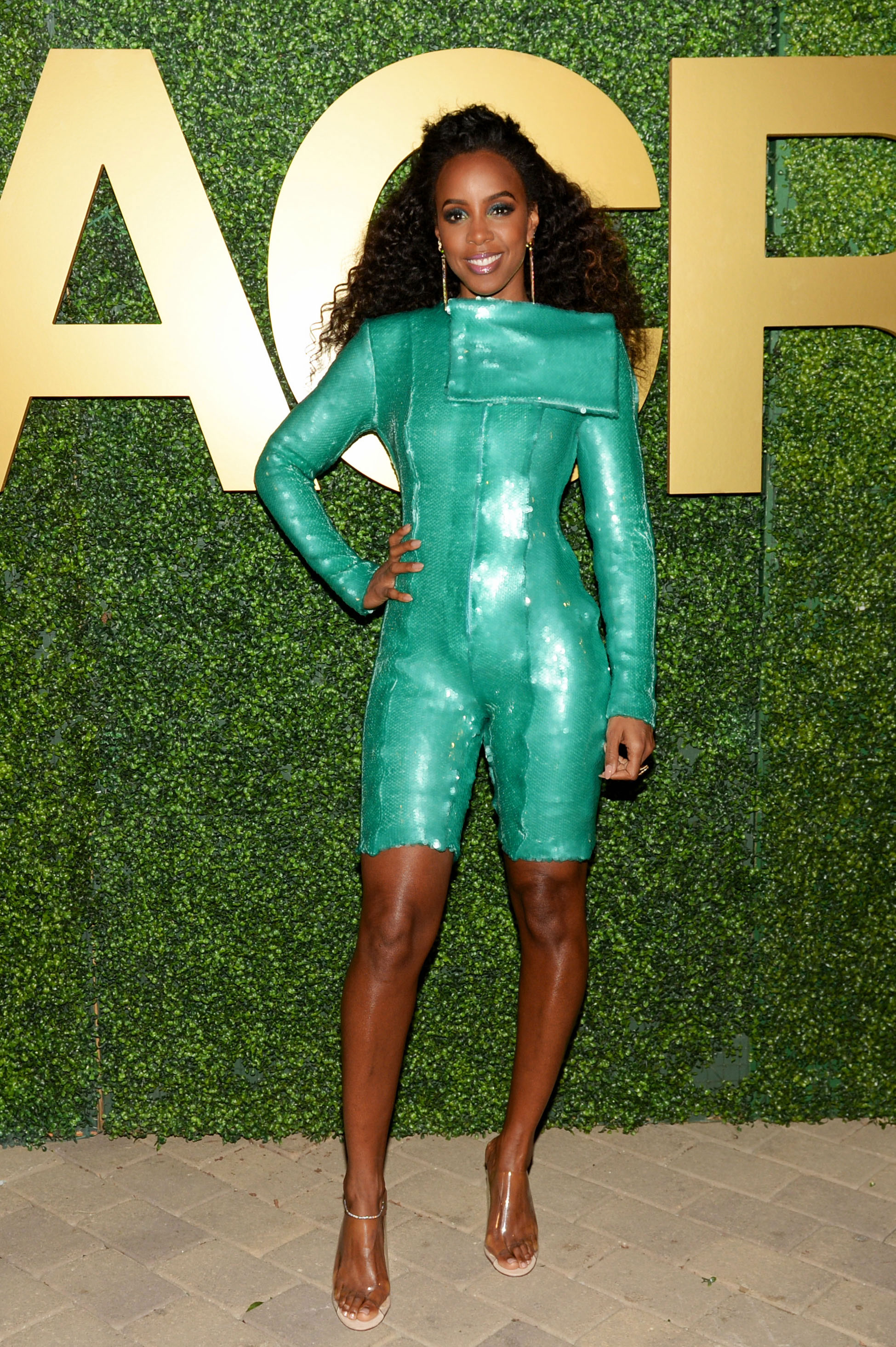 Kelly Rowland MACRO - One-third of Destiny's Child made her way to the ESSENCE x MACRO party, rocking a skintight green sequin playsuit.
