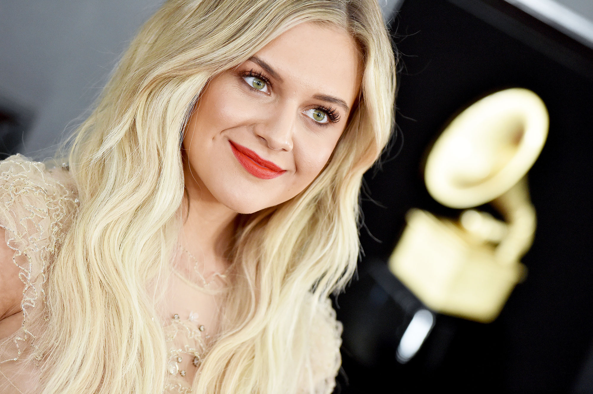 "grammys 2019 Kelsea Ballerini - Hot lips! The 'I Hate Love Songs' singer's makeup artist, Kelsey Deenihan, wanted to create ""an ethereall look with a pop of color,"" she says, so she layered two unexpected pout products to create the fiery hue: A coat of eos Ruby Tint lip balm was topped with Charlotte Tilbury's Hot Lips lipstick in the shade Tell Laura ."