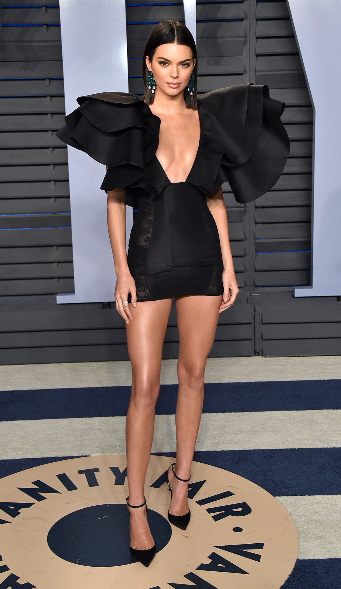 Kendall Jenner through the years - For Vanity Fair 's 2018 Oscars afterparty, Kendall rocked a Giambattista Valli creation. What the dress lacked in length, it made up for in shoulder ruffles!