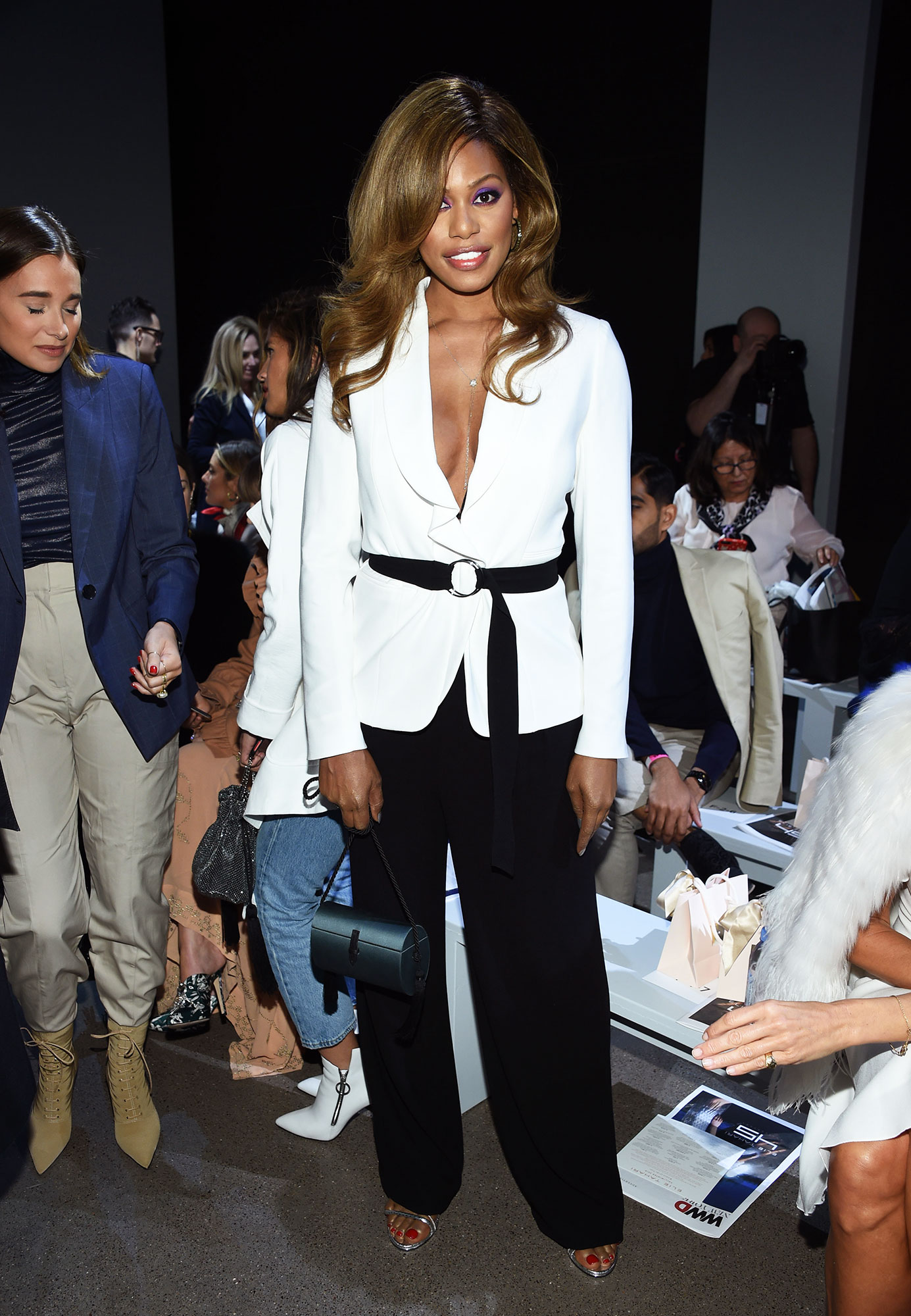 Laverne Cox - The Orange is the New Black actress sat front row at Elie Tahari on February 7 looking smokin' hot in a crisp white jacket sans shirt that she tied closed with a black belt.