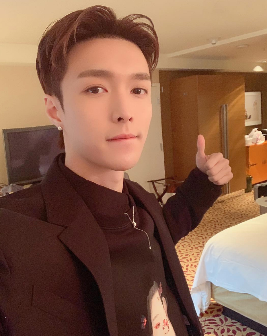 "Lay-Zhang-grammy-awards-2019 - The Chinese pop star gave the world a thumbs up from what appears to be a hotel room with the caption, ""Excited for the #grammys."""