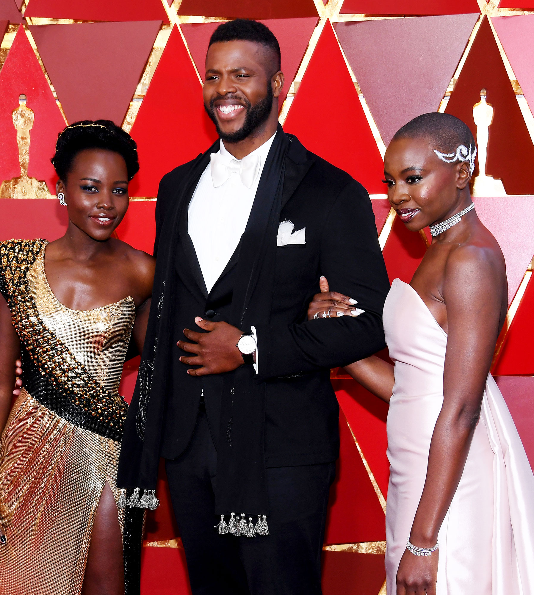 Lupita Nyong'o, Winston Duke, and Danai Gurira Lead Makeup Artist for the Academy Awards, Bruce Grayson, Shares His Number One Product and Other Behind-the-Scenes Se - (L-R) Lupita Nyong'o, Winston Duke, and Danai Gurira attends the 90th Annual Academy Awards at Hollywood