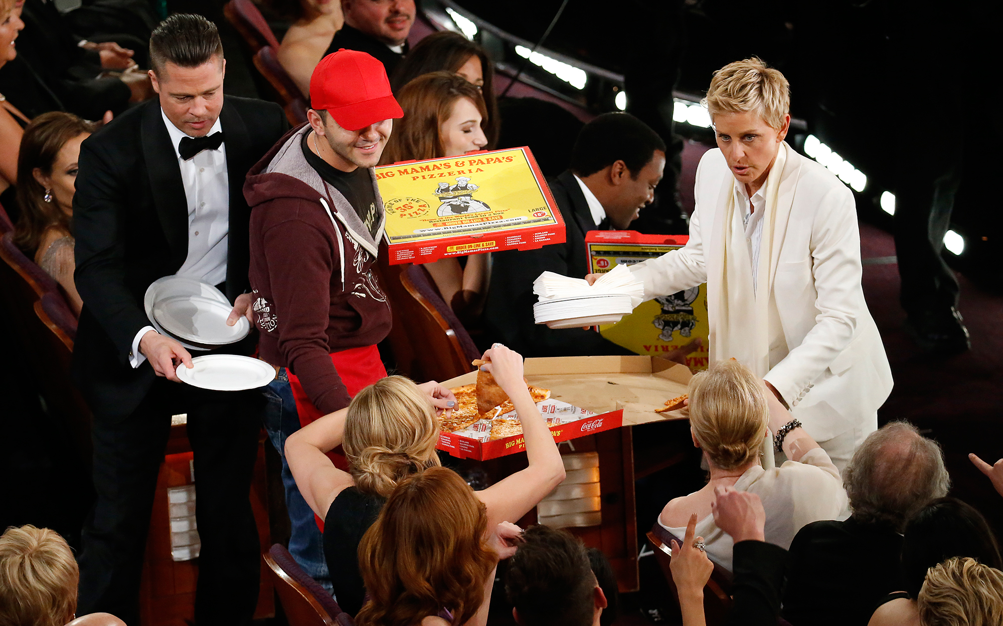 Let Them Eat! Melissa McCarthy, Gemma Chan and More Stars Who Brought Food to Awards Shows - Ellen DeGeneres has pizza delivered to the attendee during the 86th Annual Academy Awards on Sunday, March 2, 2014 at the Dolby Theatre in Hollywood, CA.