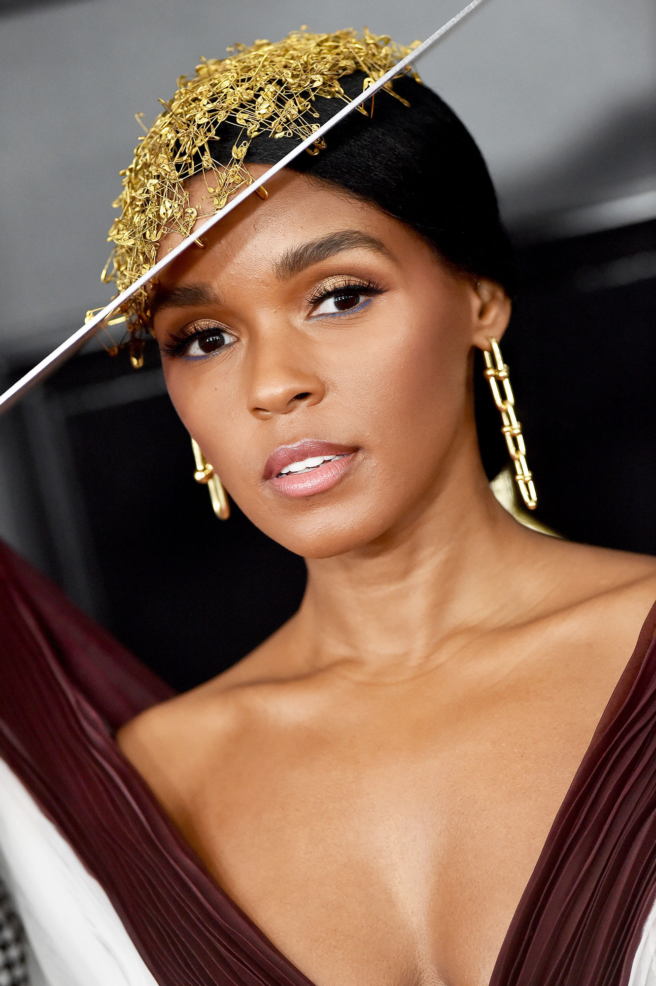 """grammys 2019 - Her funky headpiece did not distract from the Tiffany & Co. jewels the """"Make Me Feel"""" singer wore, especially her chain-like earrings."""