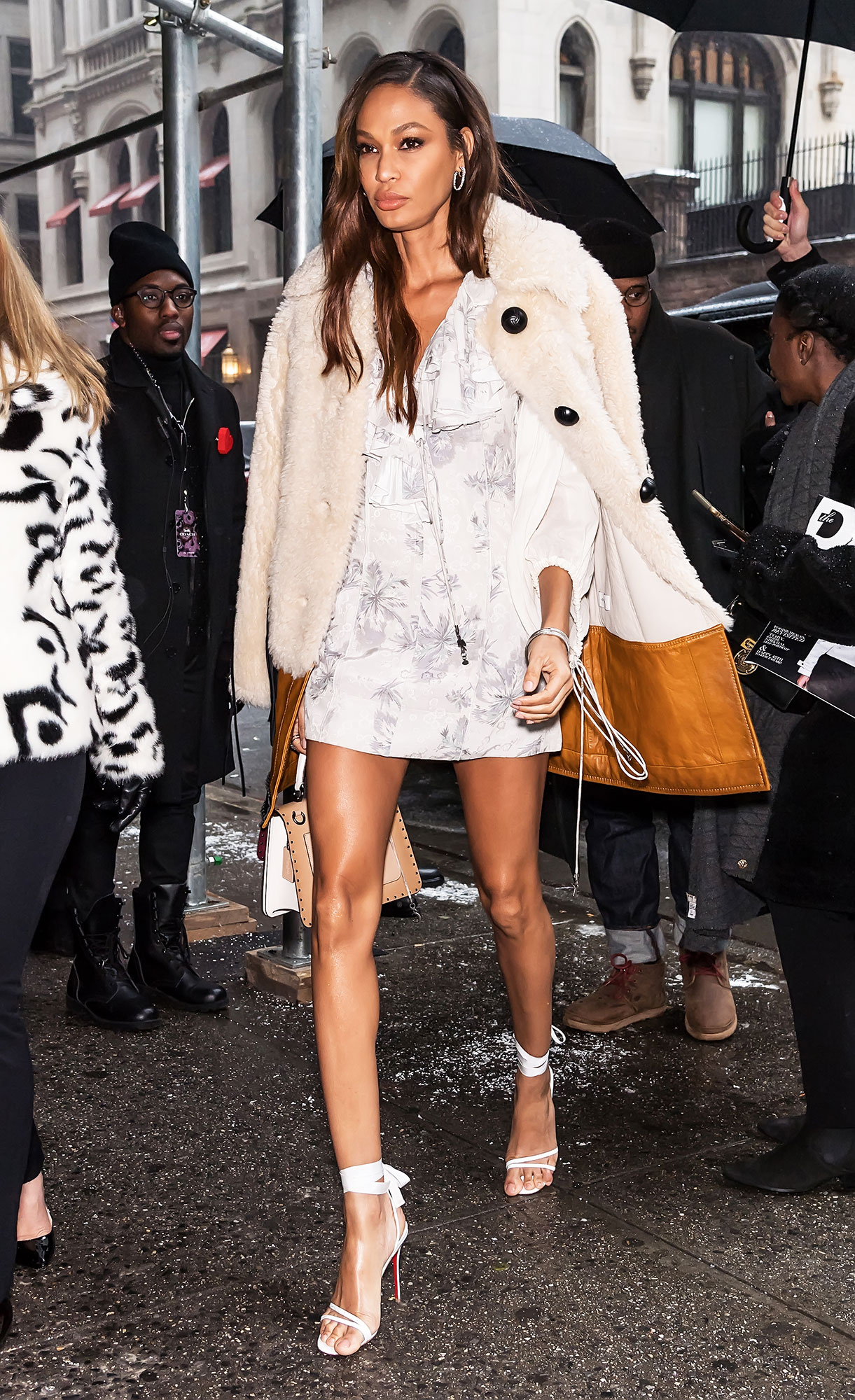 Joan Smalls - The model was seen outside the Coach 1941 fashion show in a weather-aspirational look complete with sandal heels and a white minidress.