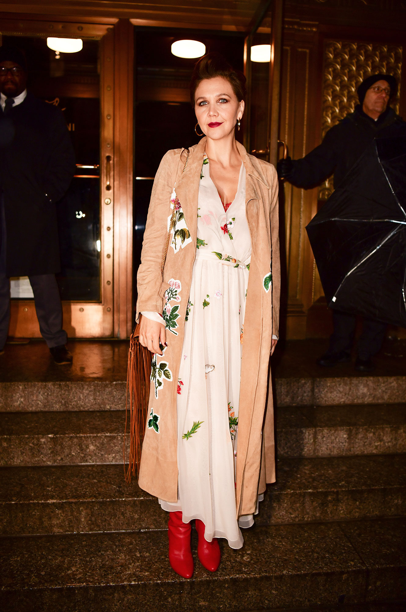Maggie Gyllenhaal - Arriving to the Oscar de la Renta show on February 12, the actress was spotted in a spring-like ensemble with a silky white dress and large flower prints on her coat.