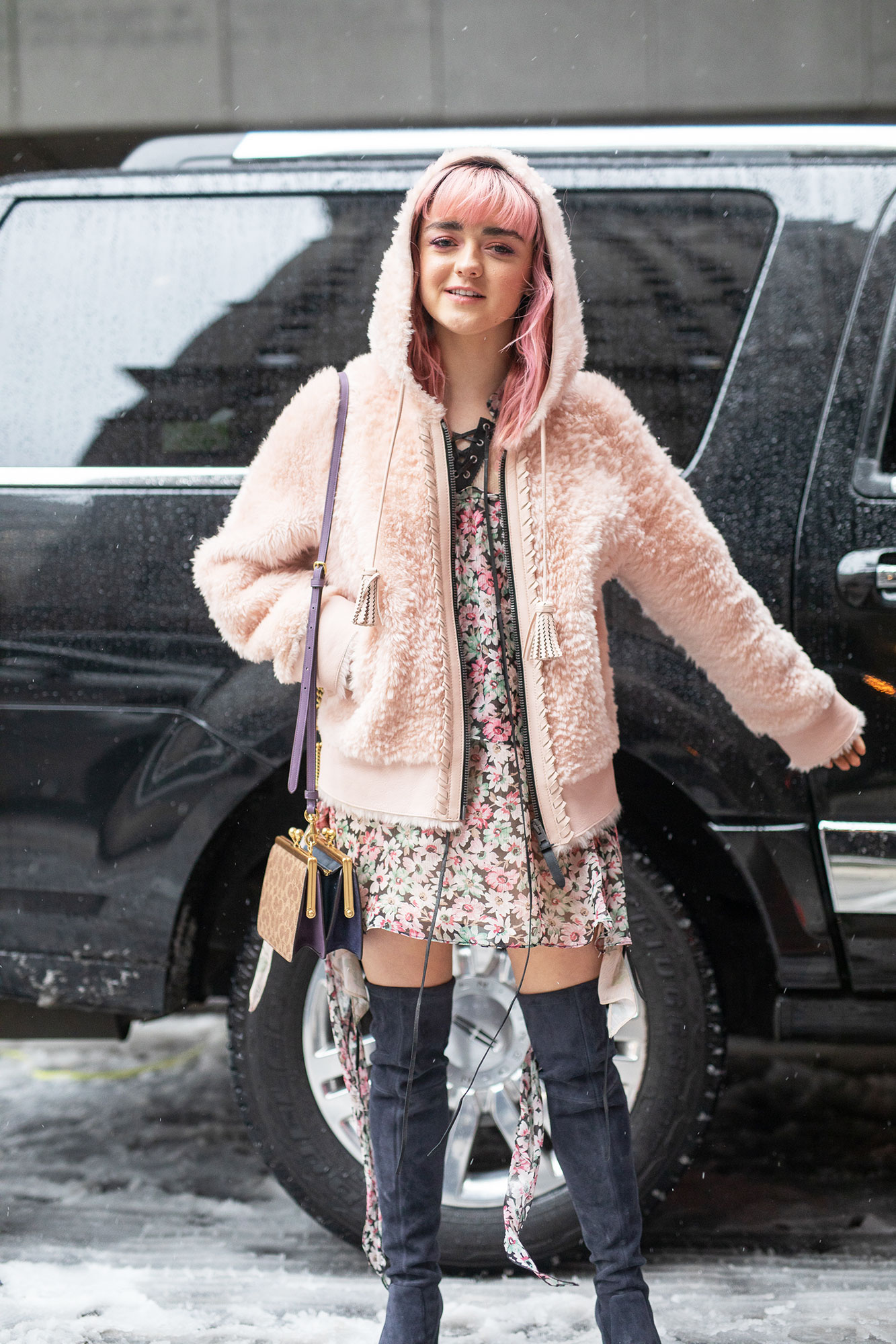 Maisie Williams - Braving the New York snow, the Game of Thrones actress wore a floral dress with a fluffy pink coat and over-the-knee navy boots.