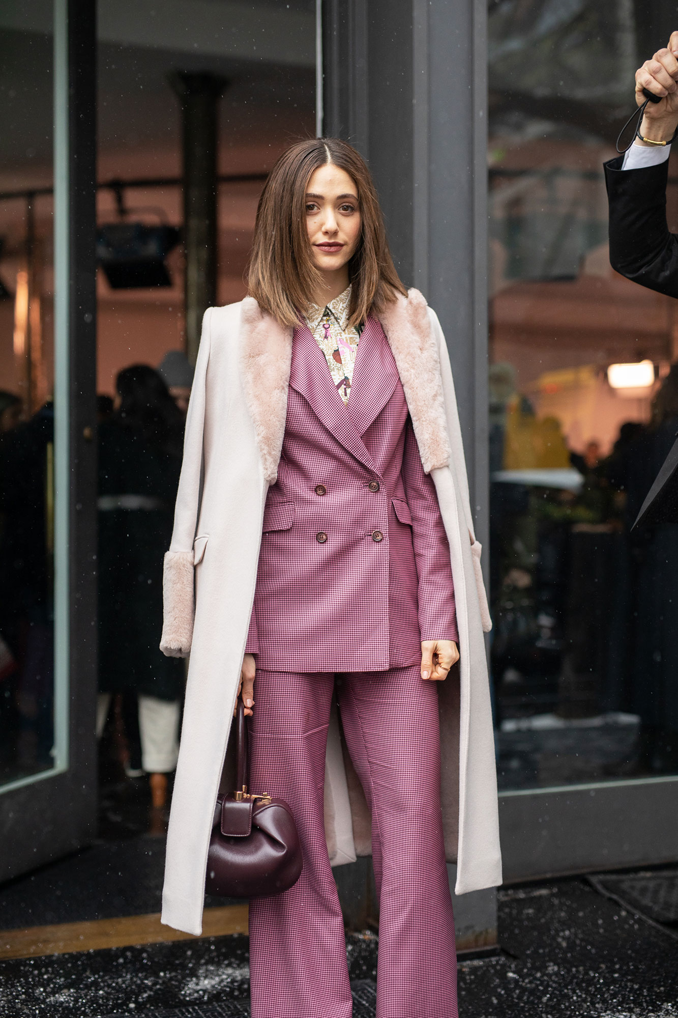 Emmy Rossum - Emmy Rossum is seen on the street during New York Fashion Week AW19 wearing pink suit with taupe coat on February 12, 2019 in New York City.