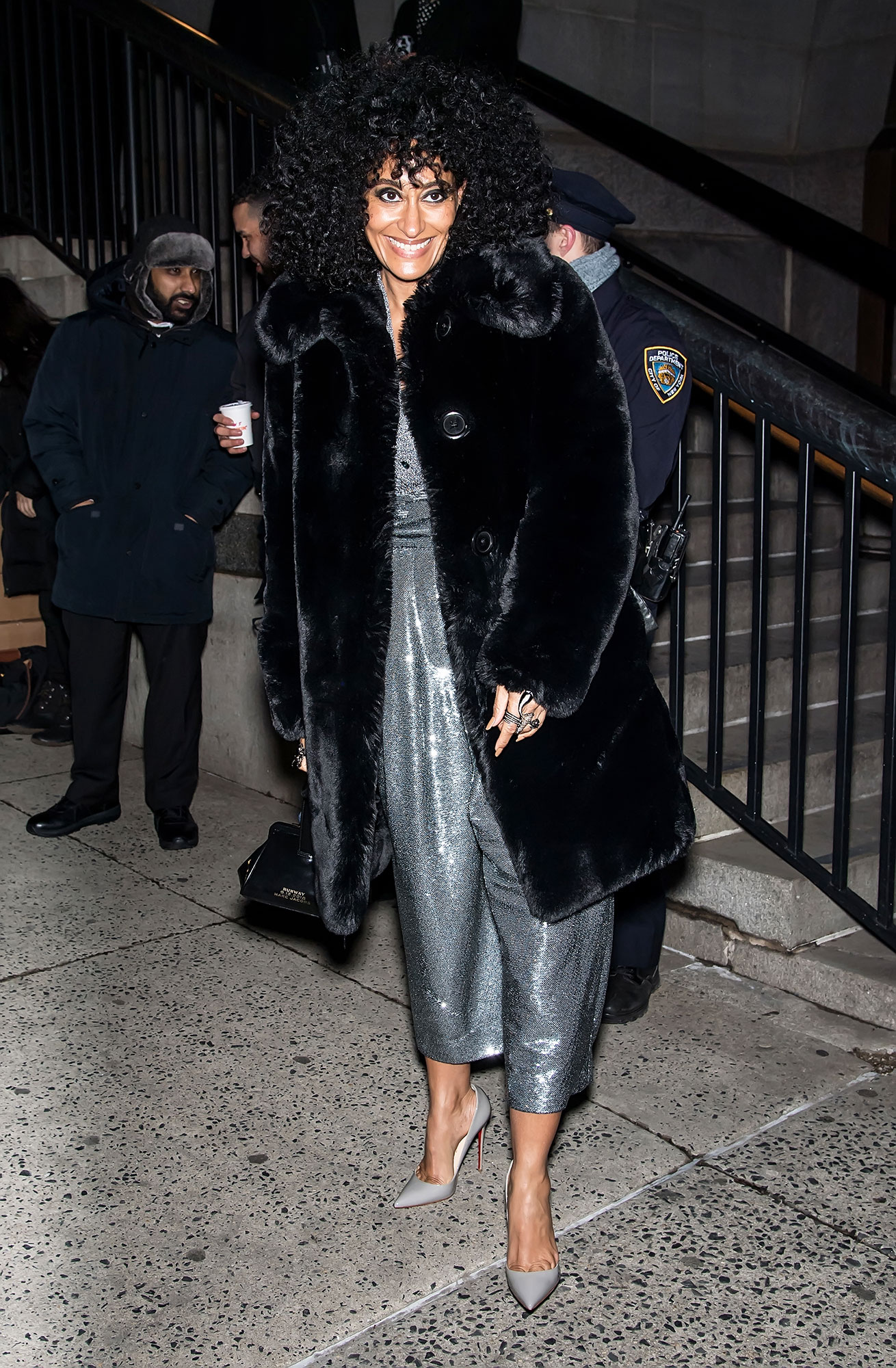 nyfw new york fashion week Tracee Ellis Ross - The Black-ish star stunned in a sequined silver jumpsuit and a faux-black fur at the Marc Jacobs show on February 13.