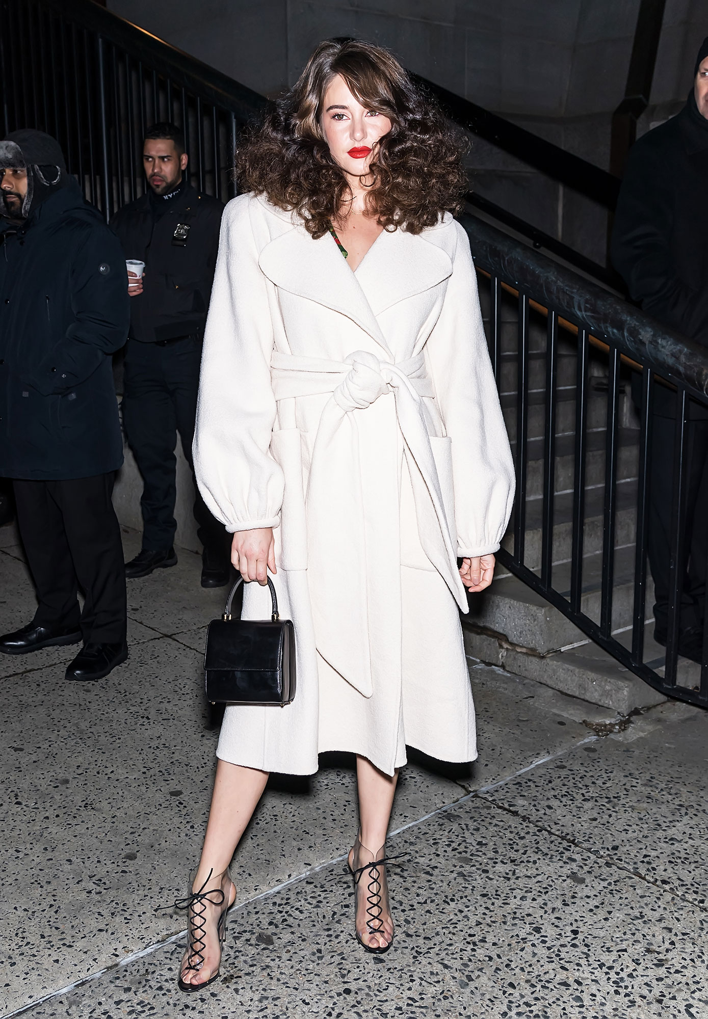 nyfw new york fashion week Shailene Woodley - For the Marc Jacobs show on February 13, the Big Little Lies actress paired her retro big-hair-red-lip beauty combo with a cream poofy-sleeve coat and lace-up heels.