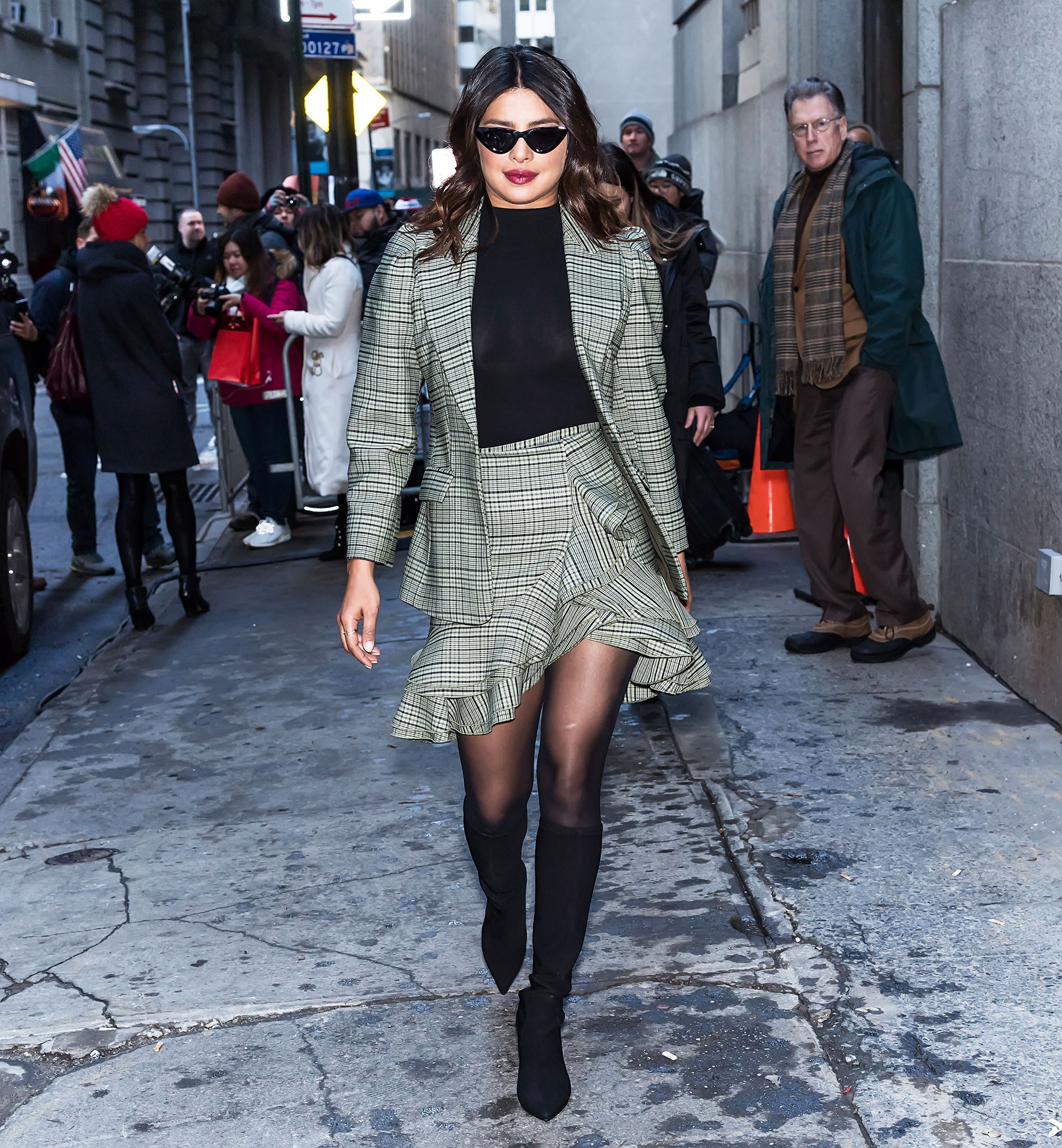 nyfw new york fashion week Priyanka Chopra Jonas - Spotted outside the Michael Kors show on February 13, the newlywed rocked a business-chic matching pinstriped skirt and suit jacket with sheer tights and skinny shades.
