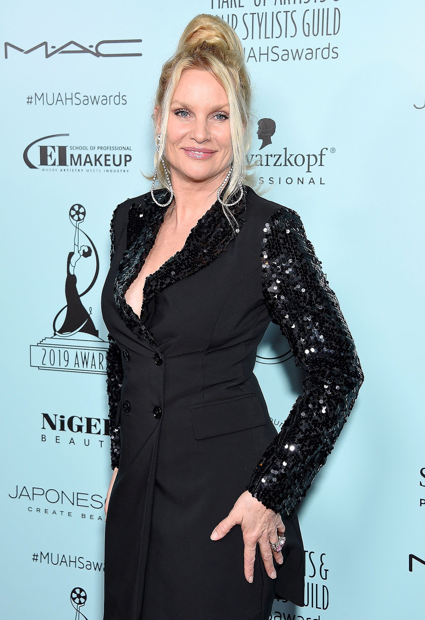 """Nicollette Sheridan GALLERY UPDATE: Shocking TV Exits - In February 2019, Sheridan announced her decision to leave Dynasty , after taking the role of Alexis Carrington amid much fanfare midway through the CW reboot's first season. """"Working on the Dynasty reboot and reprising the iconic role of Alexis has been thoroughly enjoyable, but the chance to spend precious time with my terminally ill mother is more important to me right now,"""" the actress said in a statement to Us Weekly ."""