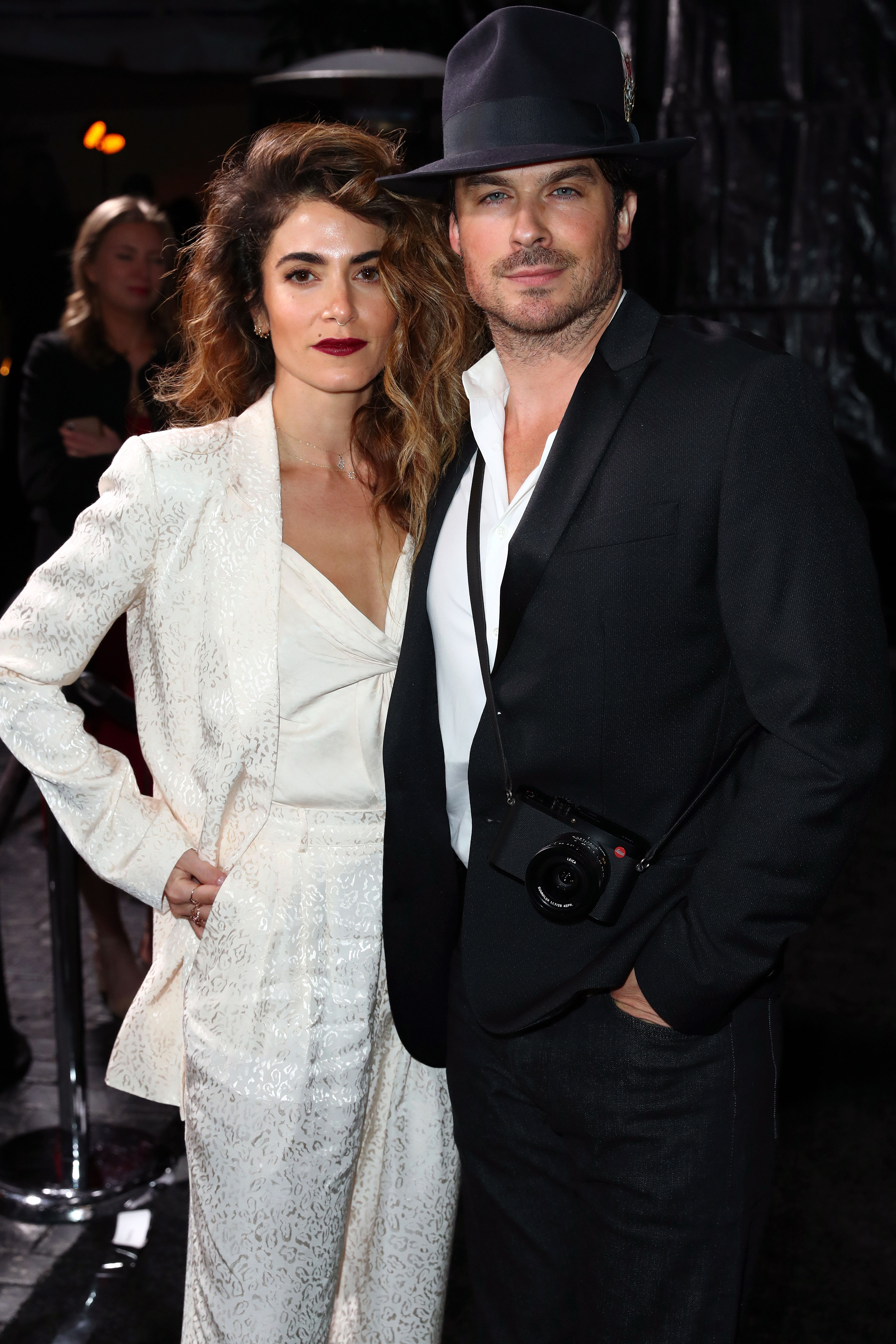 """Nikki Reed and Ian Somerhalder - The Twilight alum and the former Vampire Diaries lead stood side by side at the Cadillac event on Thursday, February 21. The couple, who got married in April 2015 and welcomed a baby girl two years later, """"held hands while walking upstairs to the party and they were inseparable all night,"""" a source told Us."""